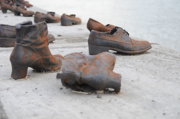 Shoes on the Danube memorial by film director Can Togay Art Budapest Can Togay Danube Day Europe Fascism History Hungary Jewish History Jewish Memorial Memorial No People Outdoors River Sculpture Shoes Shoes On The Danube Bank