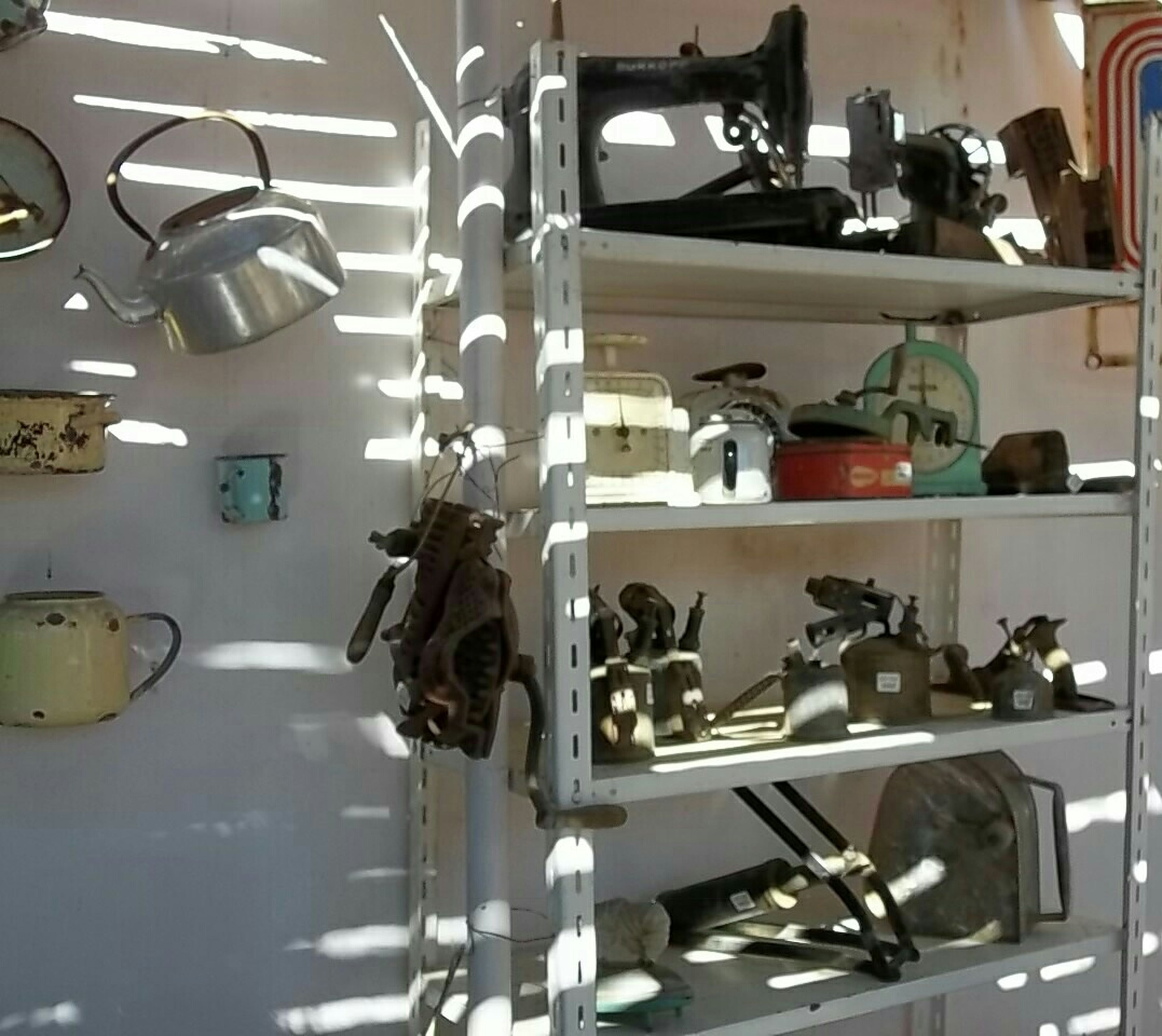 indoors, technology, hanging, variation, shelf, no people, human representation, still life, large group of objects, art and craft, wall - building feature, metal, communication, art, in a row, electricity, close-up, antique, equipment, old-fashioned