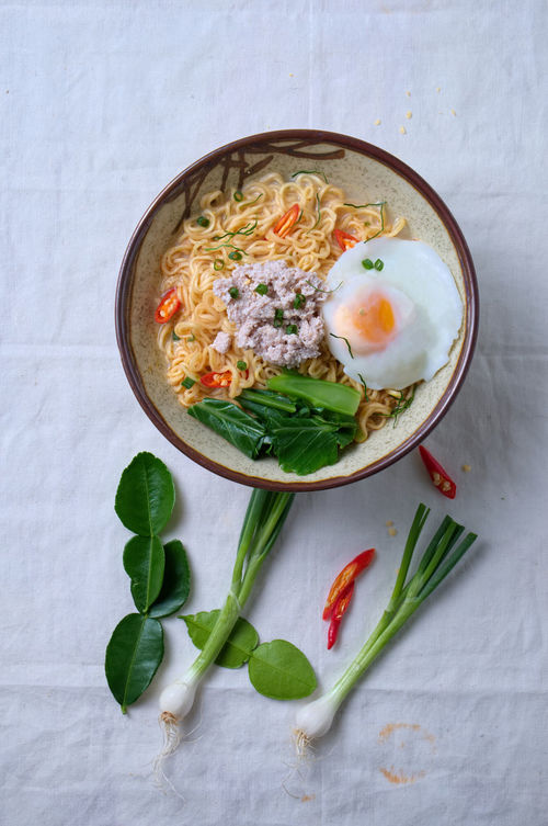 Asian Food Asian Foods Bowl Egg Food Food And Drink Freshness Healthy Eating Indoors  Kaffir Lime Leaves Kale Minced Meat No People Noodle Soup Noodles Pine Nut Plate Ready-to-eat Red Chili Pepper Spicy Spring Onion