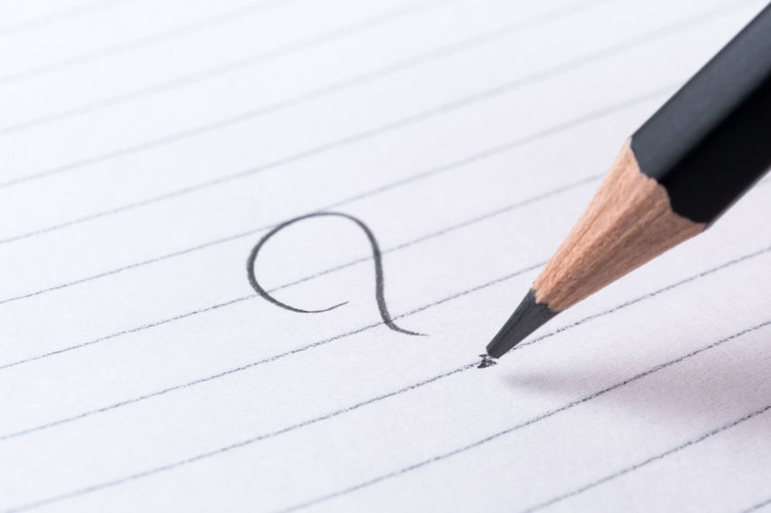 Handwritten question mark on a notepad. Shallow dof RISK What Concept Confused Confusion Dilemma Frustration Handwrite Help How Inspiration Paper Pencil Problem Query Question Mark Solution Think Thoughts Trouble When Where Who Whom Why