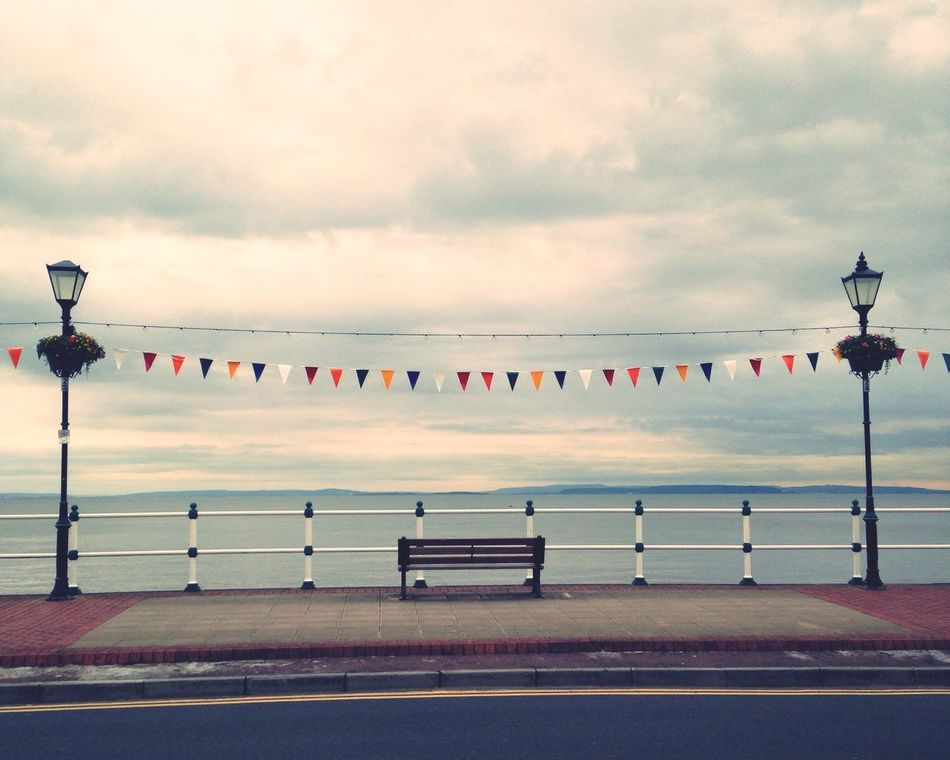 Sunny day in Penarth Wales Overcast Overcast Skies Seaside Bunting Celebration Quiet Quiet Moments Empty Seat Sea Sea And Sky