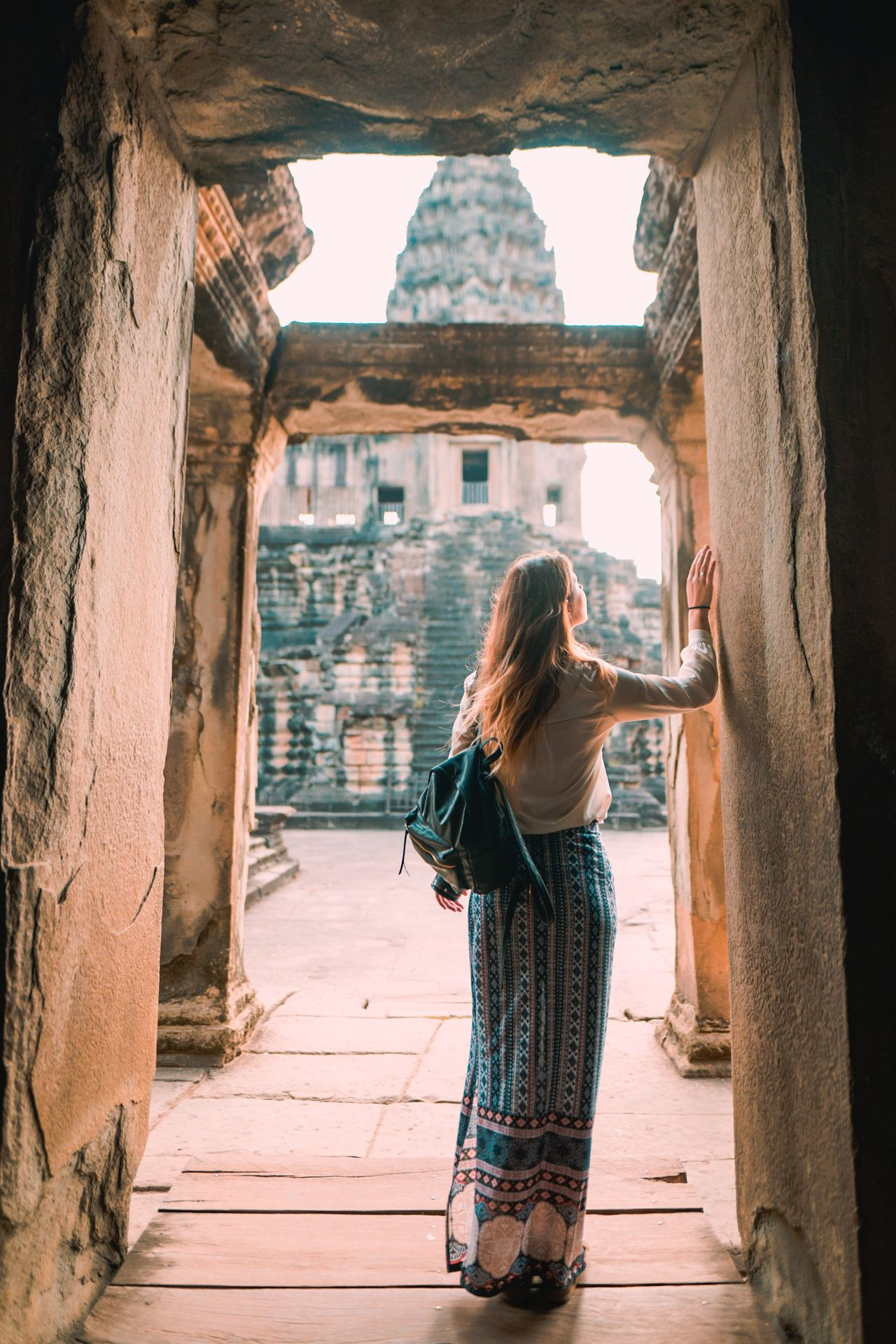 Some doors never close Architecture One Person Standing People One Woman Only Full Length Built Structure Doorway Ancient Civilization Culture Showcase May Angkor Wat Travel Destinations History Travel Building Exterior Travel Photography ASIA Architecture Cambodia Tourism Temple Wonder Of The World The Great Outdoors - 2017 EyeEm Awards