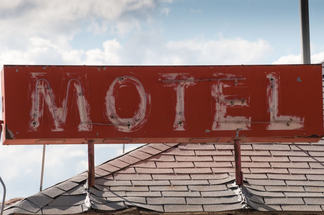 Old Motel Sign Abandoned Abandoned Buildings Capital Letter Close-up Day Derelict Derelict Building Information Information Sign Motel Motel Sign No People Old Old Motel Sign Old Sign Outdoors Peeling Paint Red Red Sign Text Western Script