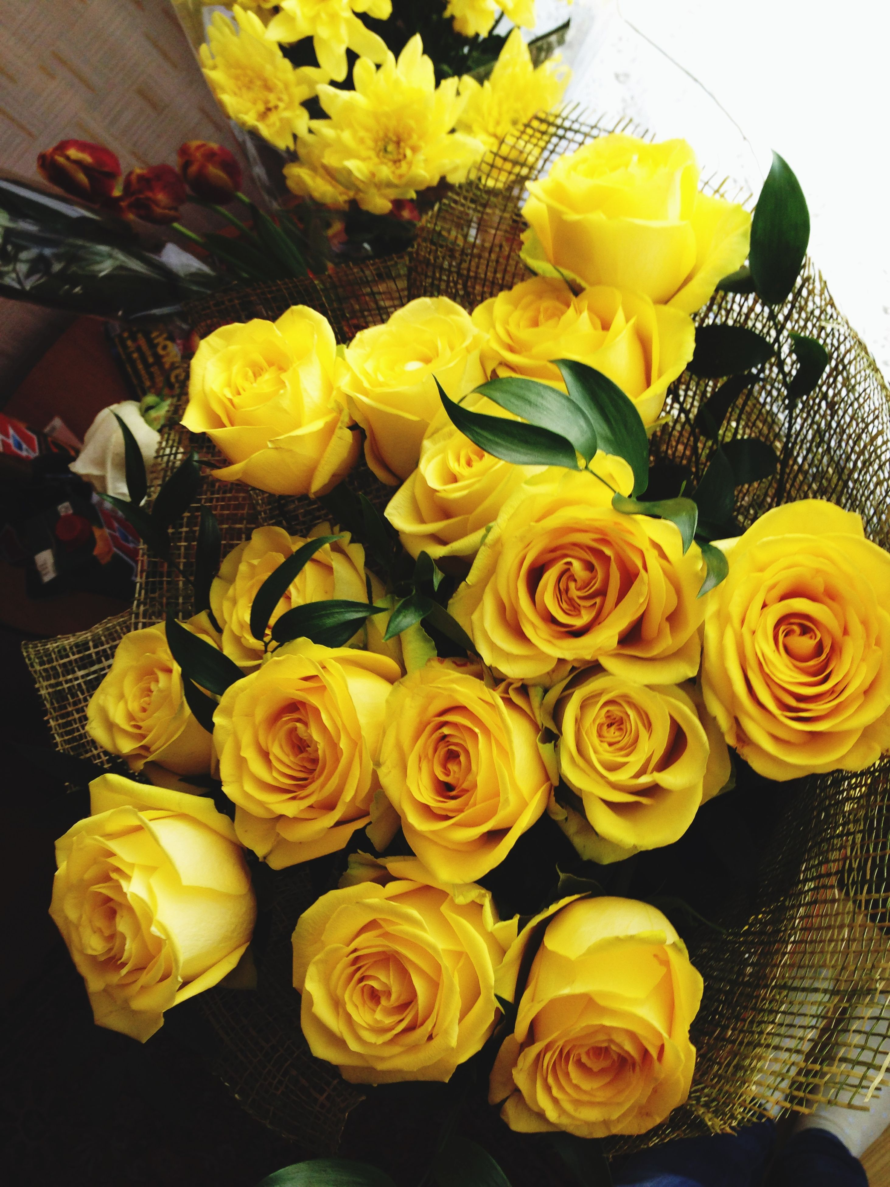 freshness, flower, indoors, variation, fragility, rose - flower, yellow, still life, petal, flower head, multi colored, bouquet, high angle view, close-up, food and drink, arrangement, vase, table, food, flower arrangement