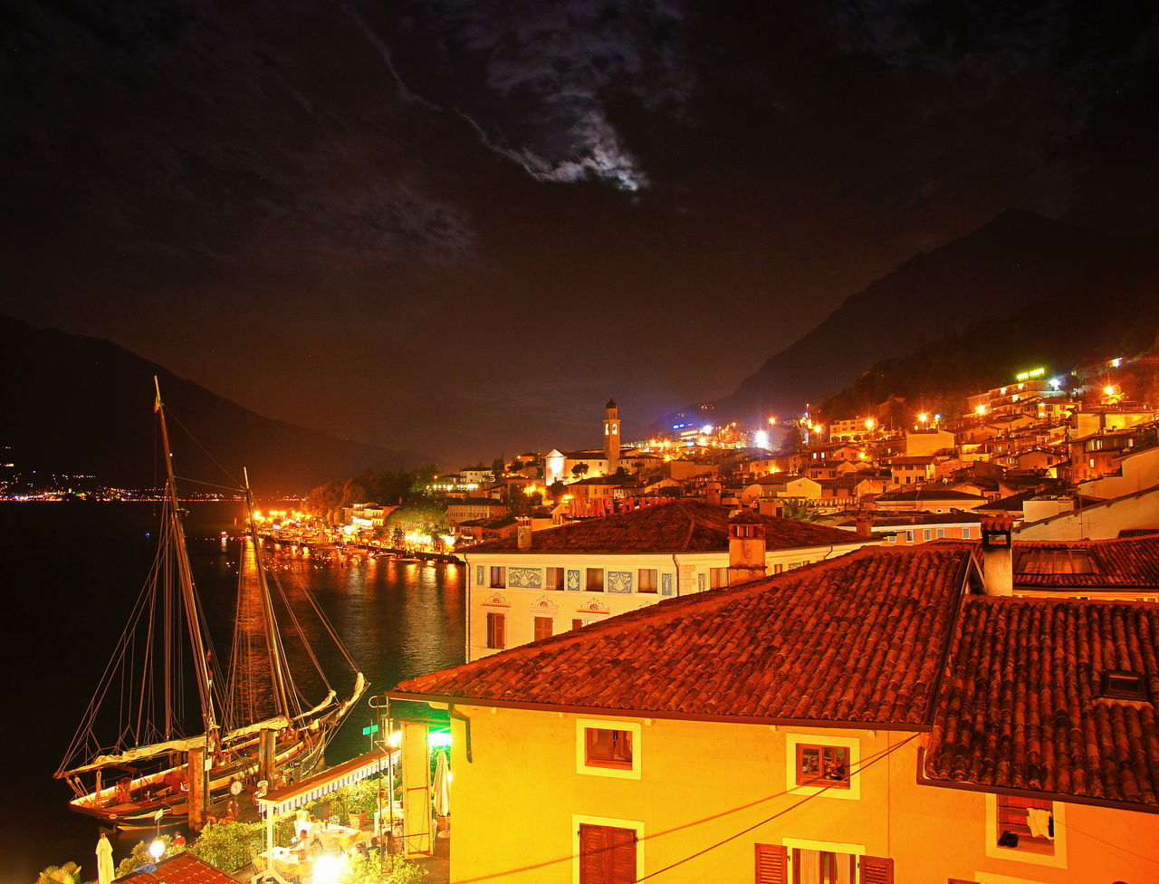 Above The Roof Above The Roofs Architecture Building Exterior Built Structure City Cityscape Cloud - Sky Clouds And Sky EyeEmNewHere Illuminated Lago Di Garda Lake Lake Garda Lights Limone Sul Garda Night No People Outdoors Sailboat Sky Windmade