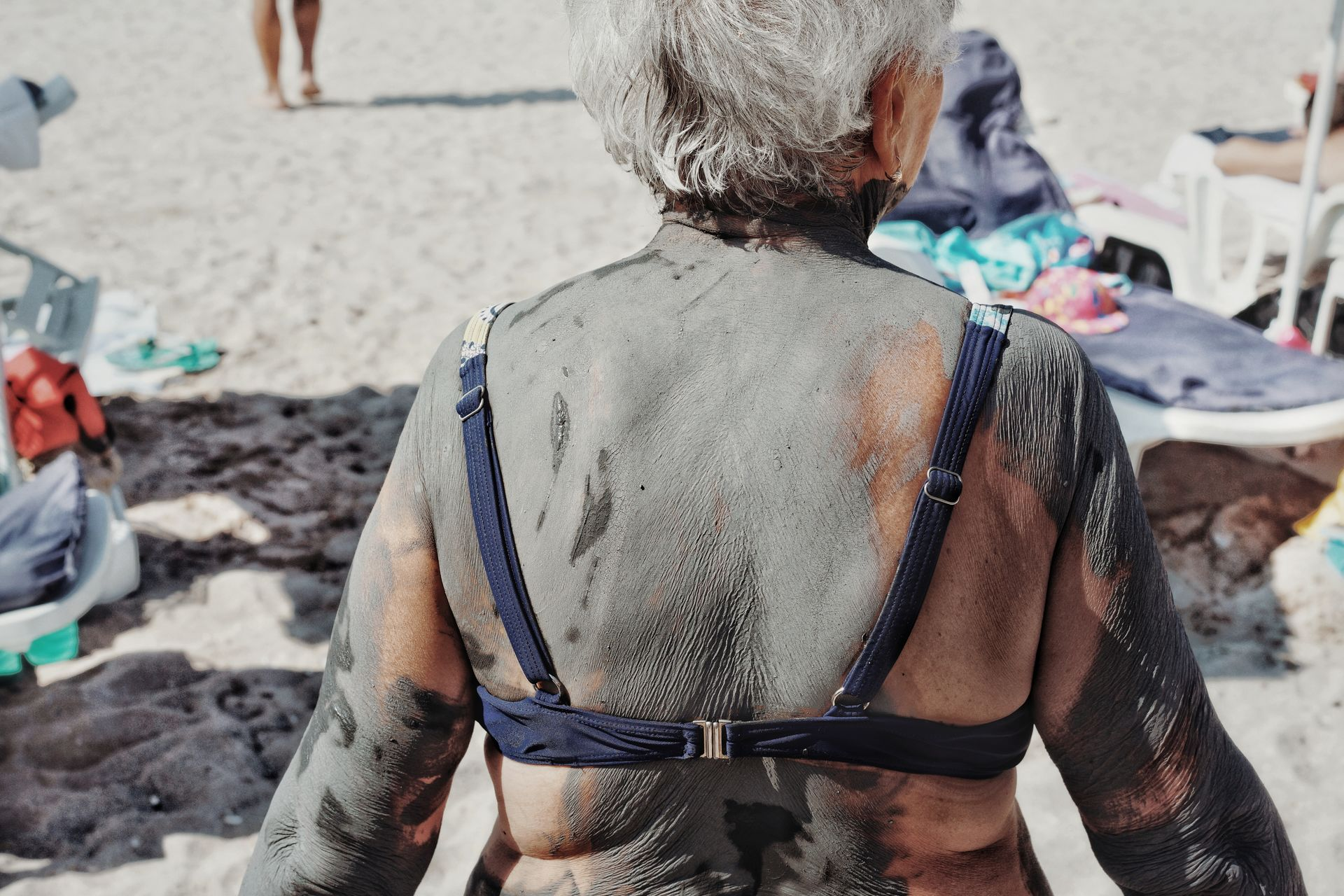 Rear view sand mud beach people swimsuit one woman only old woman Covered in mud one person Beach Life summer sun lounger muddy human neck