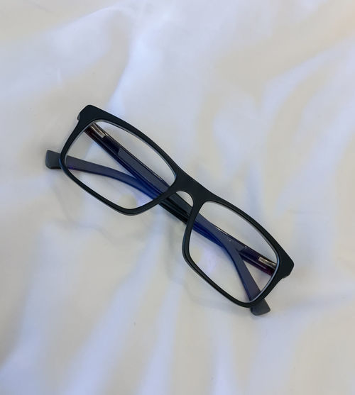 Care Eye Care Fashion Modern New Black Close-up Eye Eyeglass Eyeglasses  Eyeglasses  Eyewear Glass Healthy High Angle View Indoors  Lifestyles No People Perspective Eyeglass Prespective Refliction Still Life Sunglasses Table