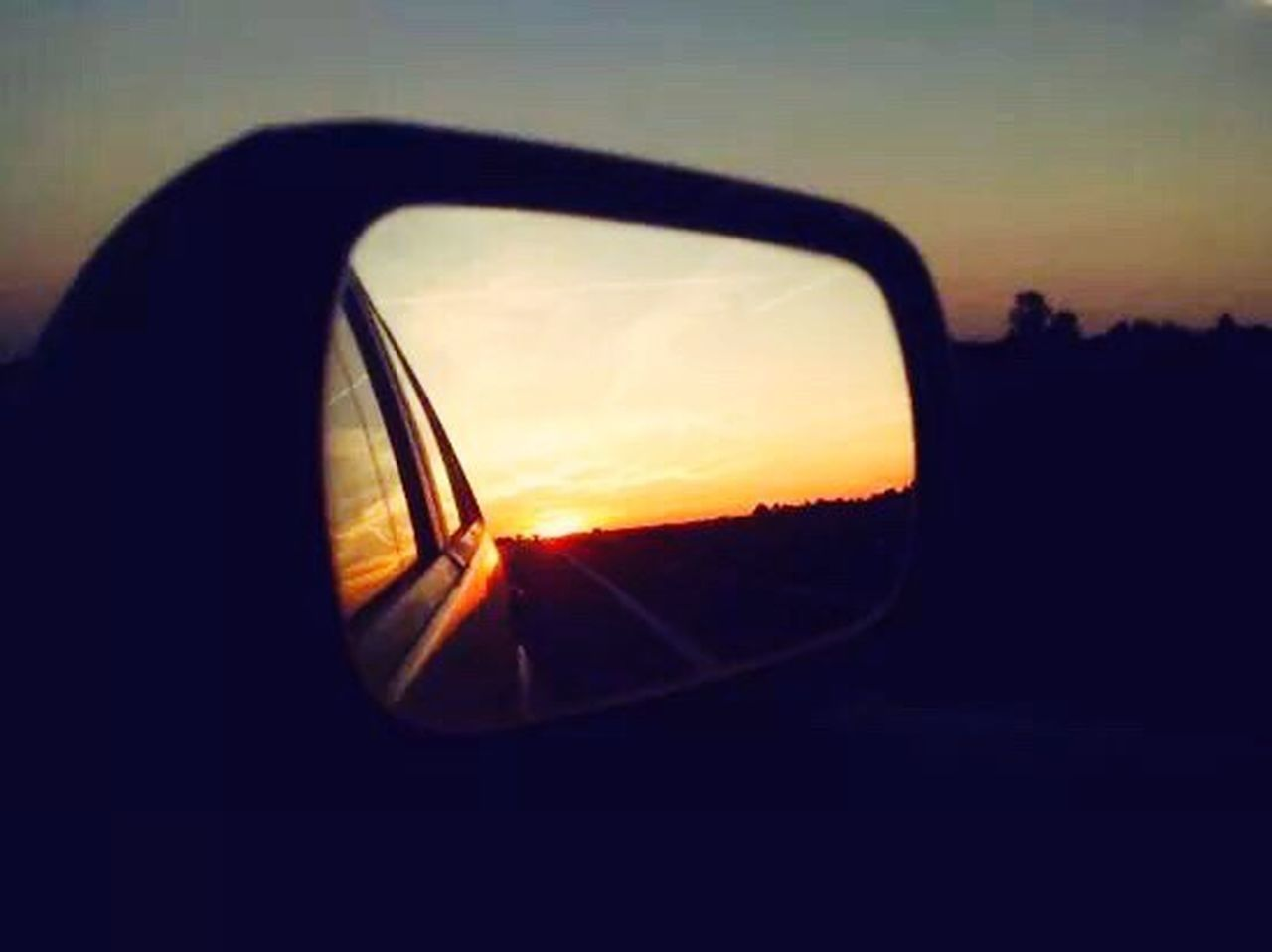 car, sunset, side-view mirror, transportation, reflection, vehicle mirror, land vehicle, mode of transport, road, sky, sun, no people, silhouette, outdoors, road trip, nature, day, close-up
