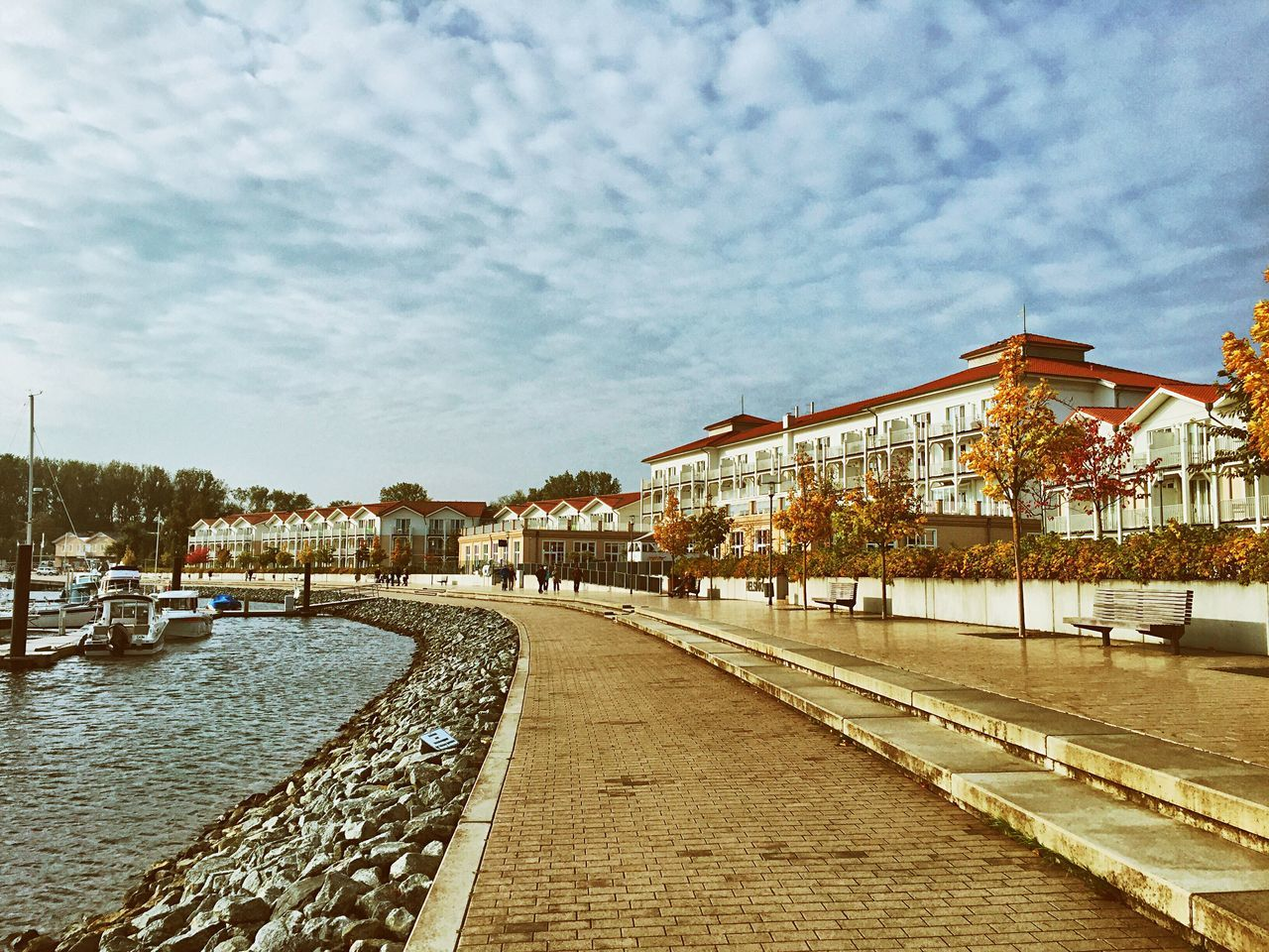 Architecture Building Exterior Built Structure Cobblestone Water Cloud City Sky Long Walkway Empty The Way Forward Day Pathway Outdoors Calm Cloud - Sky Waterfront Sea Ostseebad Boltenhagen