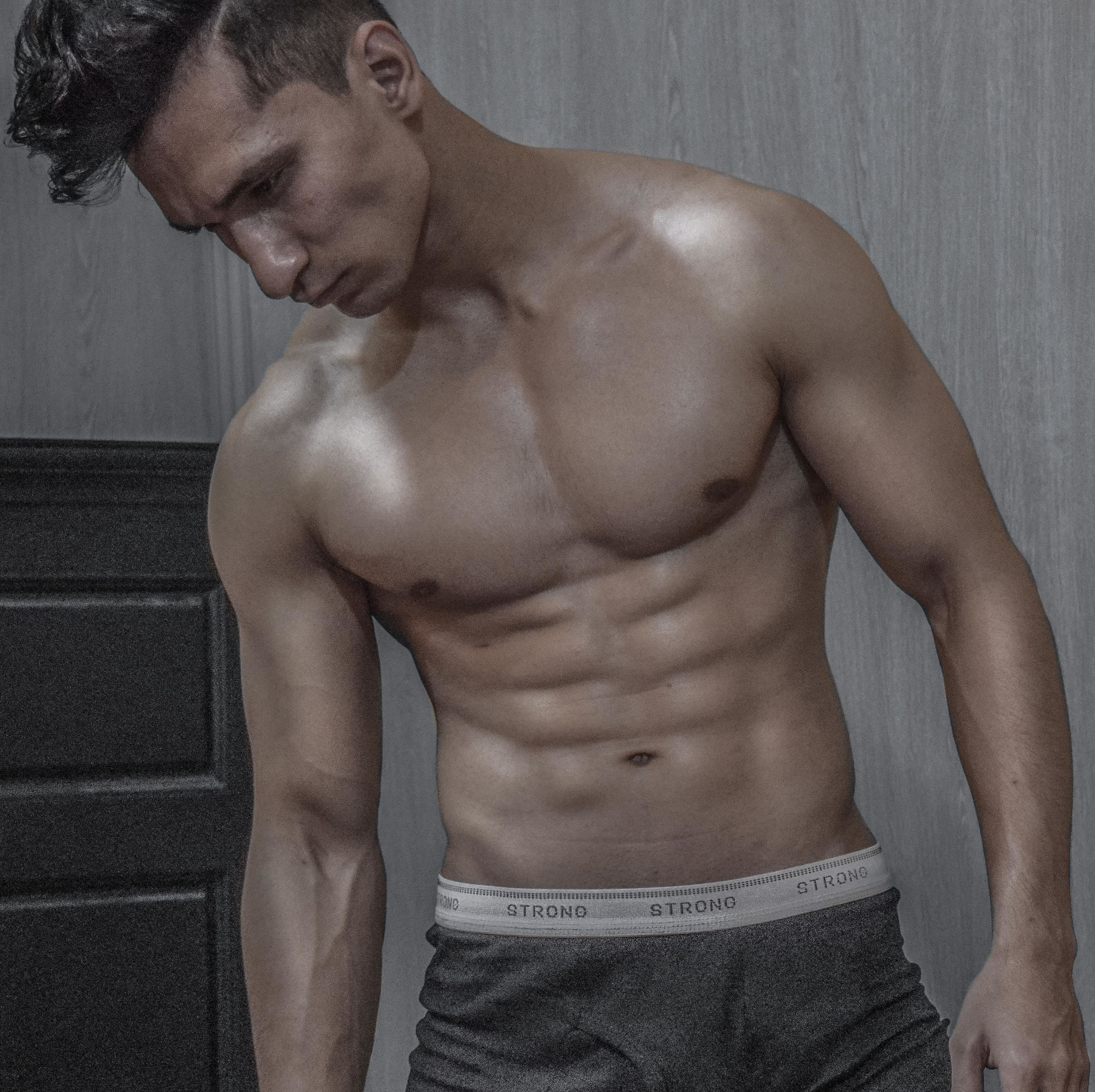 indoors, lifestyles, young adult, young men, person, leisure activity, bonding, love, wall - building feature, shirtless, togetherness, casual clothing, front view, eyes closed, relaxation, three quarter length, mid adult, men