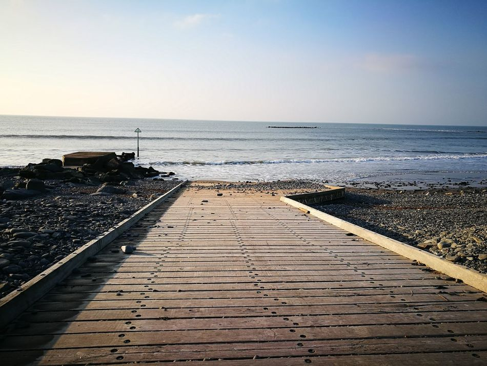 Beach Water Sky Nature Clear Sky Beauty In Nature No People Outdoors Sea Pier Wood Wooden Day Tranquility Horizon Over Water The Way Forward Tranquil Scene Scenics