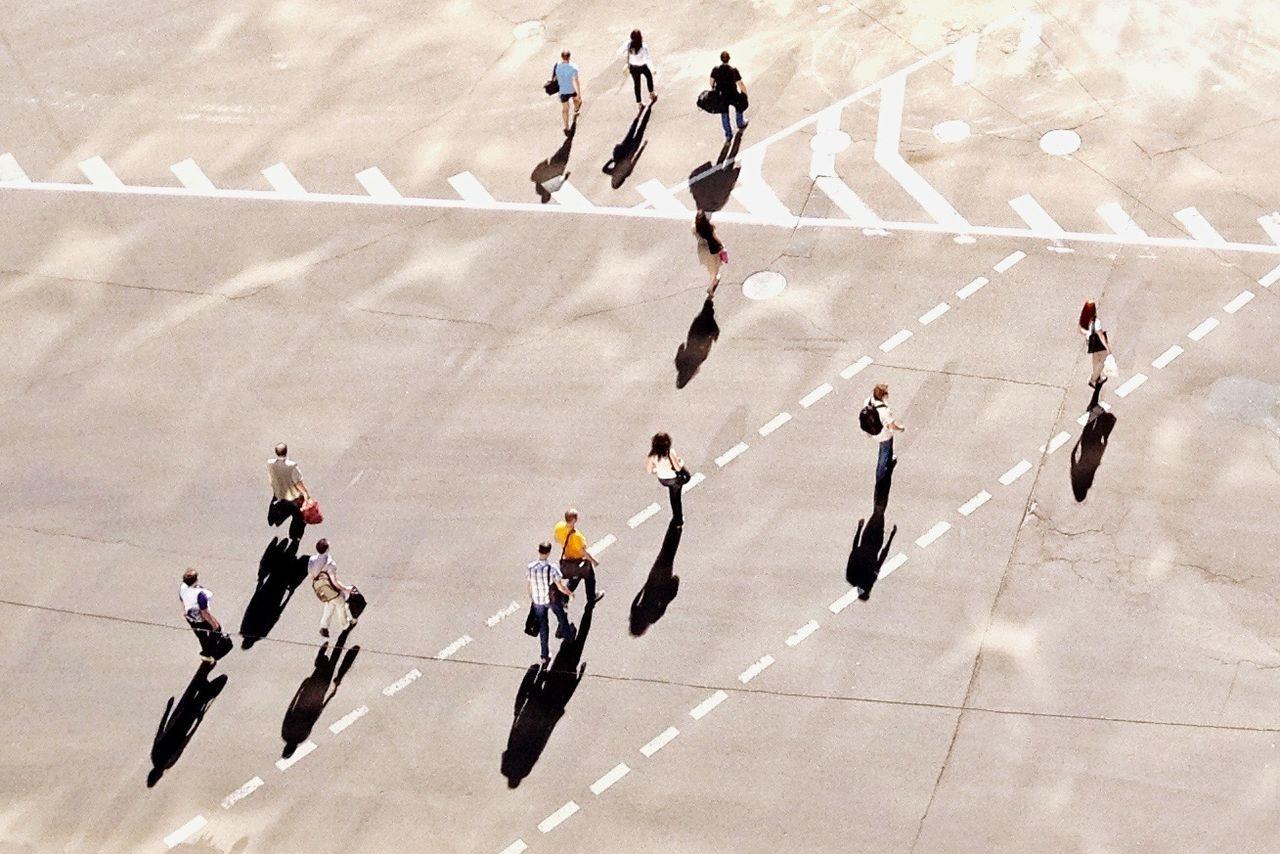 Tilt-Shift Image Of People Walking On Street In City