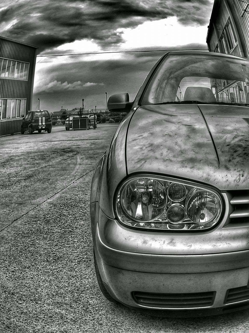 car, transportation, land vehicle, headlight, mode of transport, outdoors, no people, day, building exterior, close-up, sky