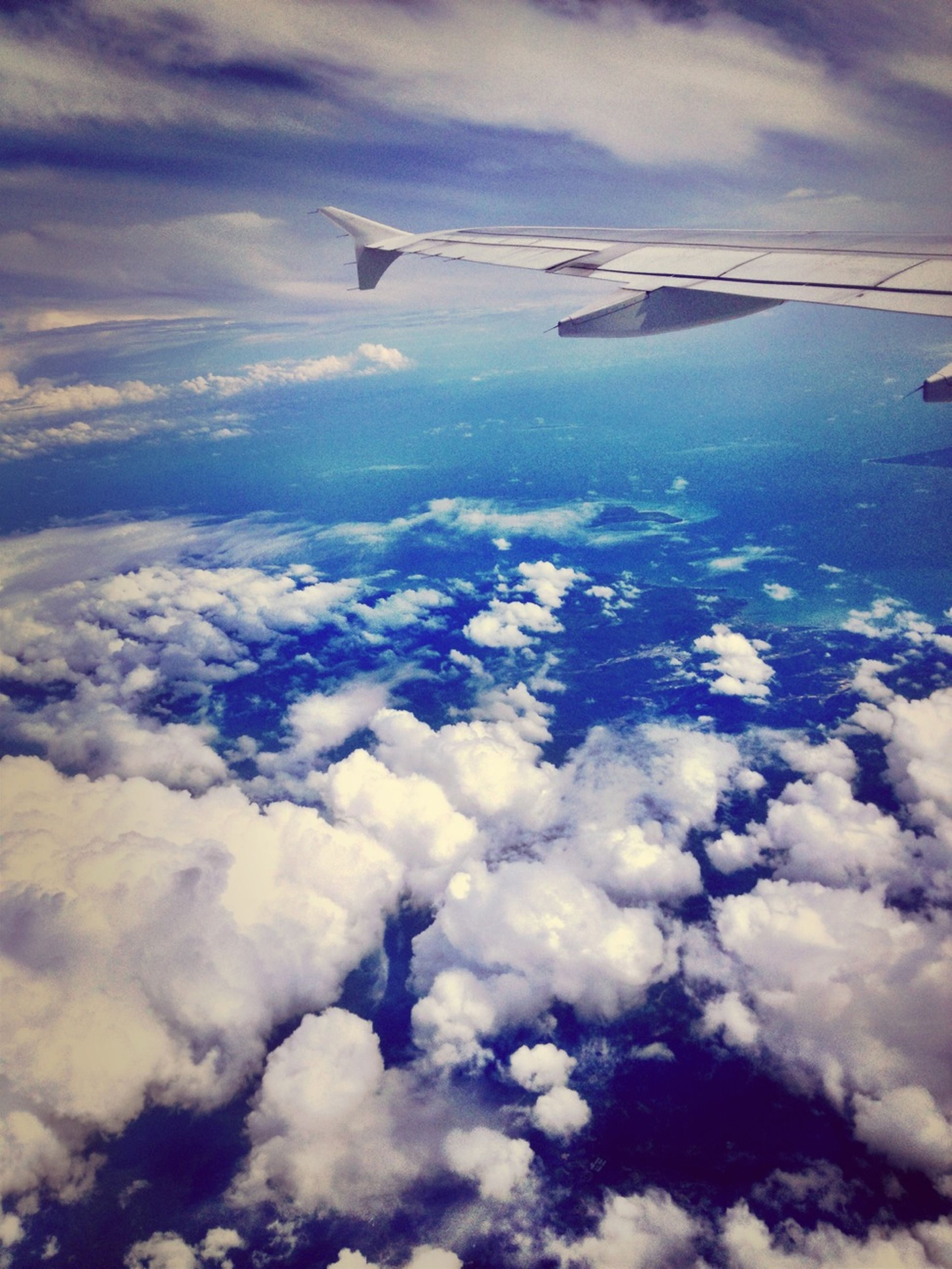 airplane, flying, air vehicle, aircraft wing, aerial view, transportation, sky, mode of transport, cloud - sky, scenics, cloudscape, beauty in nature, mid-air, part of, public transportation, nature, travel, journey, cloud, tranquil scene