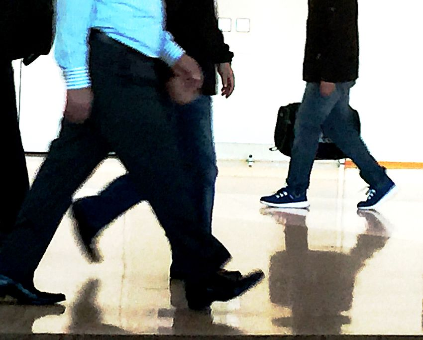 Airport terminal with passengers Airport Terminal Floor Hurrying Indoors  Legs Luggage Passengers Phone Camera Real People Reflective Surface Rushing Shoes Suitcase Torsos Travelers Walking