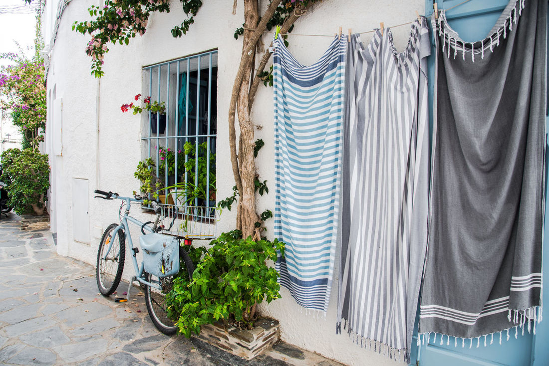 Hanging Nature Plant Summertime Travel Travel Photography Tree Ambiance Architecture Bicycle Blue Building Exterior Lifestyle Photography Lifestyles Mode Of Transport No People Outdoors Pastel Street Summer Towel Transportation Travel Destinations Travel Guide Window