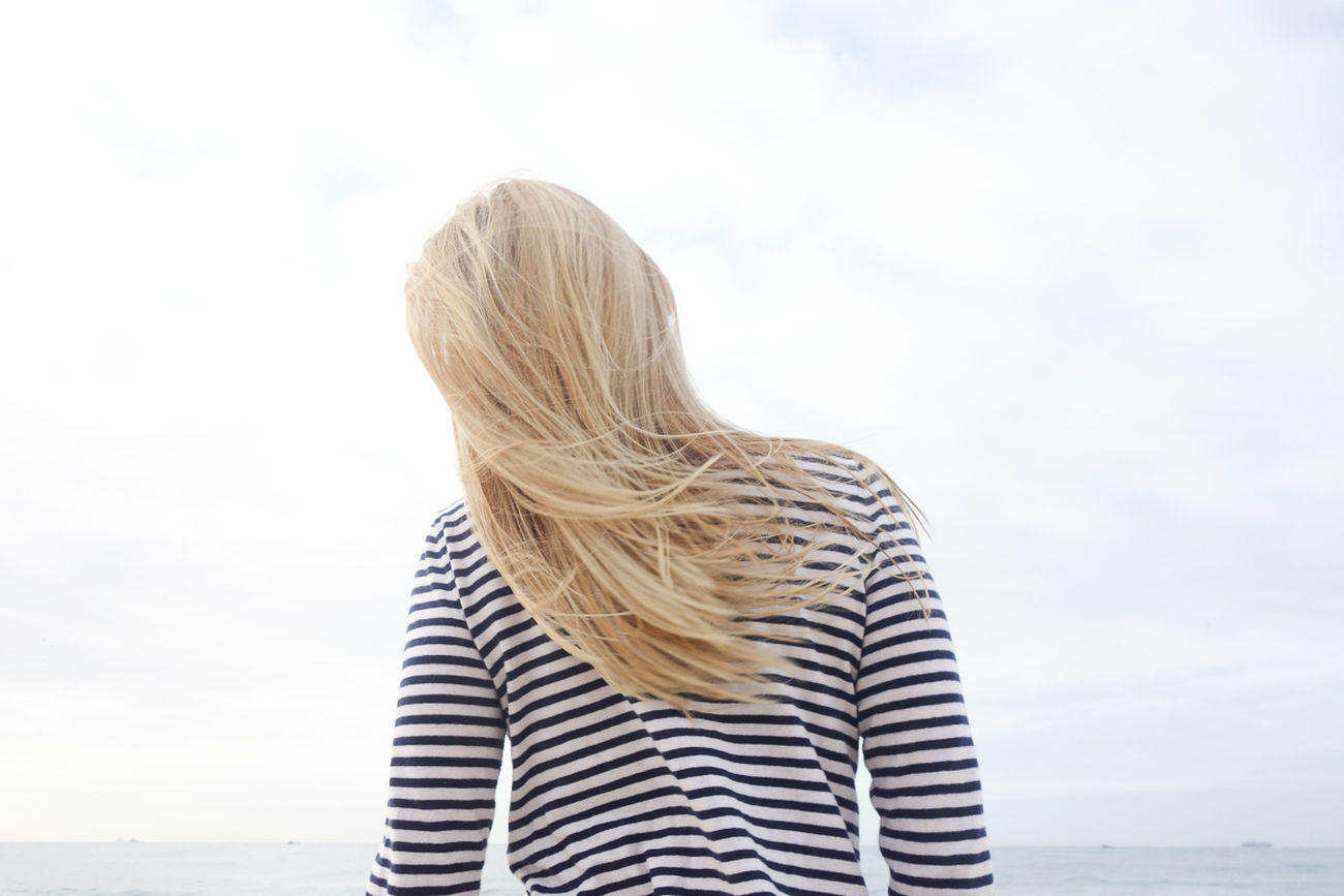 Blond Hair Blonde Casual Clothing Getting Away From It All Head And Shoulders Lifestyles Long Hair Negative Space Real People Sky Young Women
