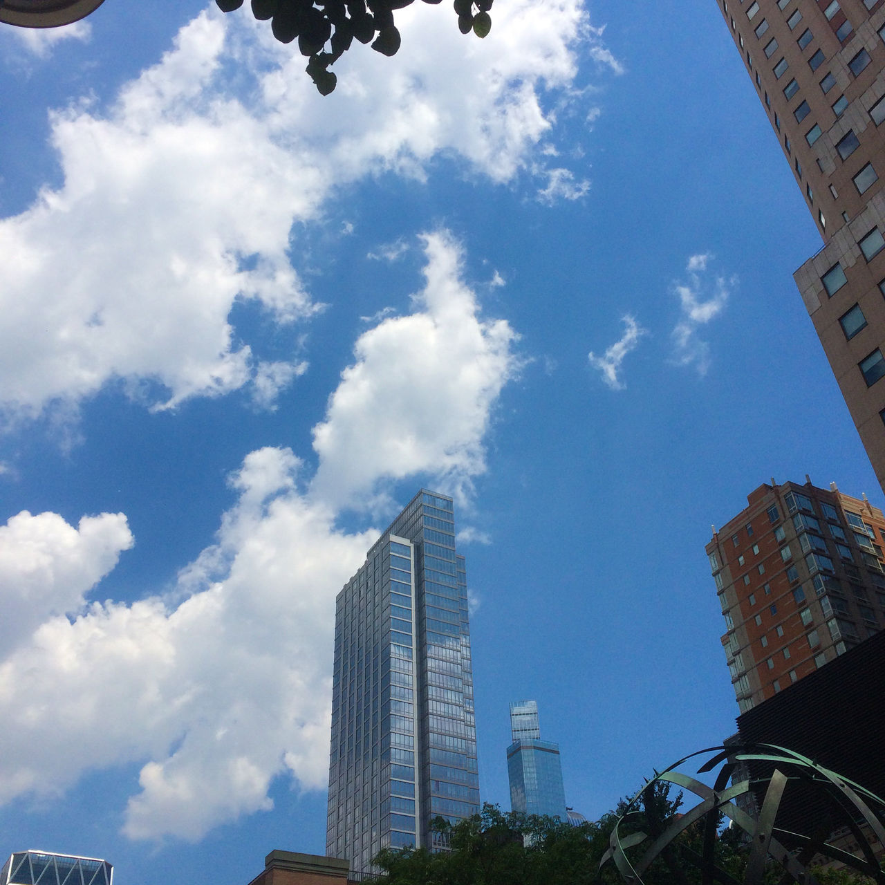 Buildings reach up to the sky, invisible cities in mid-town Manhattan Architecture Blue Building Exterior Business Finance And Industry City Cityscape Cloud - Sky Clouds And Sky Day Dia Glass Building Invisible Cities Low Angle View Manhattan Modern New York City New York ❤ No People Outdoors Reach Up To The S Reflection Sky Skyscraper Urban Skyline