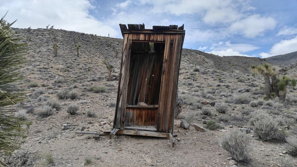 Outdoors No People Sky Nature Day Cloud - Sky Architecture Outhouse The Oaks Trails Photos EyeEmNewHere EyeEm Best Shots Death Valley, California Lost Burro Mine Lost Burro Mine, Death Valley National Park Death Valley National Park Mining History Of America Dunny Miles Away Wood Structure Mining Camp Mining Cabin Photography In Motion Travel Architecture Long Goodbye