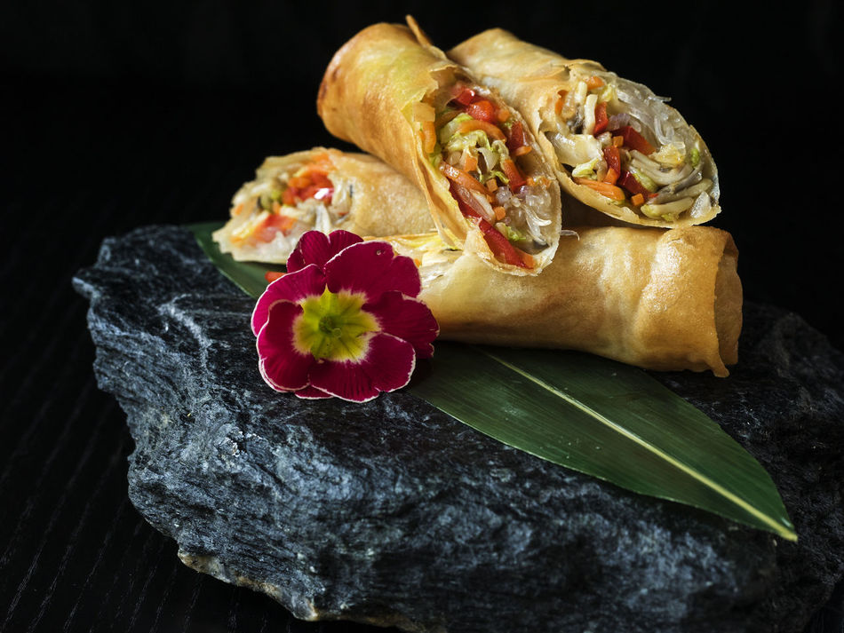 Asian-style Pancakes crunchy with vegetable filling, served on slate Asian  Asian-style Black Crunchy Filling Flower Food Freshness Garnish Indoors  No People Pancakes Ready-to-eat Red Served Slate Stone Style Vegan Vegetable Vegeterian