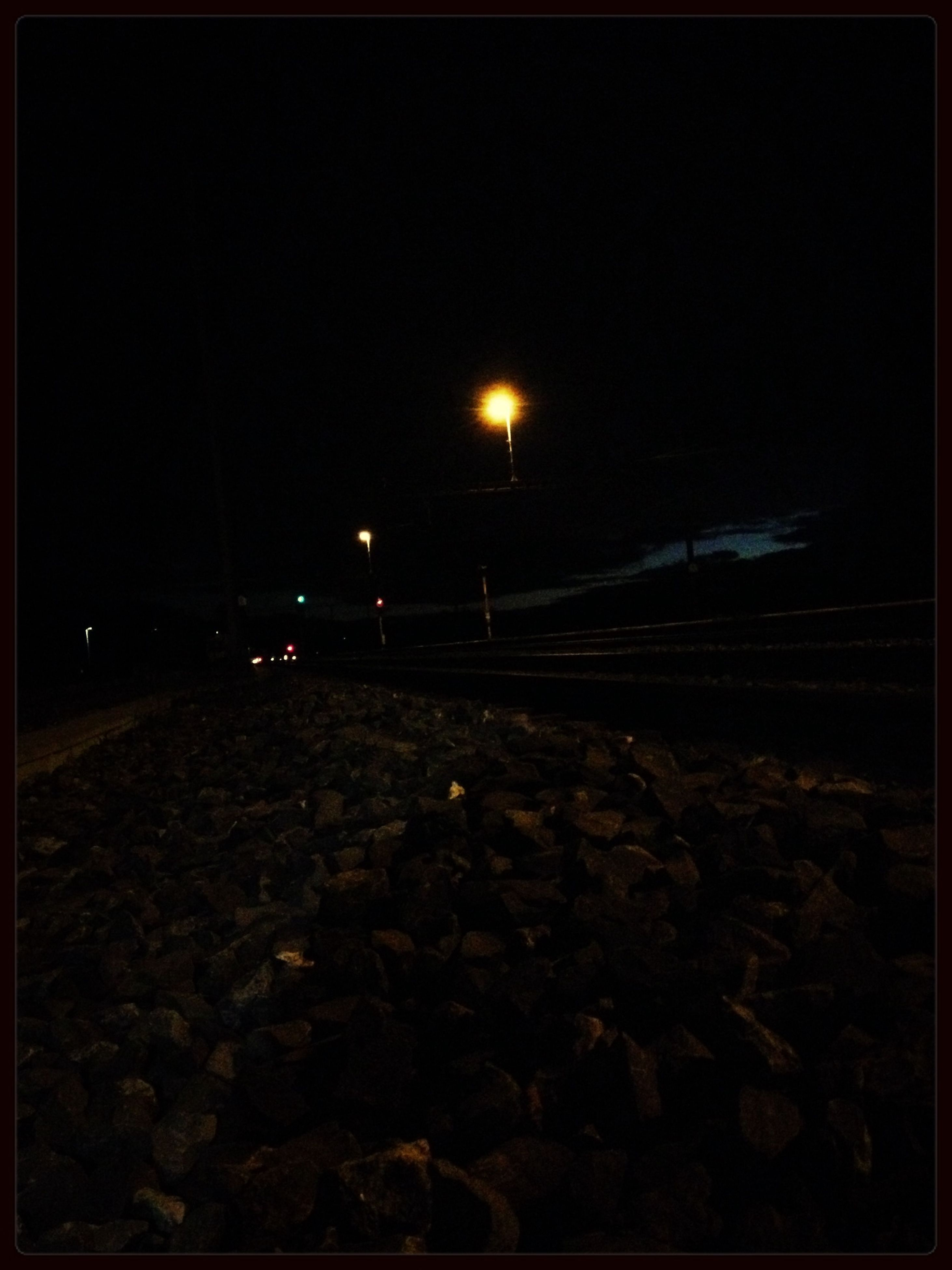 night, dark, transfer print, illuminated, copy space, auto post production filter, low angle view, electricity, lighting equipment, clear sky, transportation, street light, no people, light - natural phenomenon, outdoors, built structure, silhouette, sky, architecture, street
