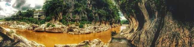 River after the rain. Tree Rock - Object Tranquility Nature Tranquil Scene Tree Trunk Water Rock Formation Growth Outdoors Scenics Day Beauty In Nature Rock No People Cloud - Sky Non-urban Scene Solitude Non Urban Scene Growing EyeEm Nature Lover Philippines Photos Eyeem Philippines TravelPhilippines