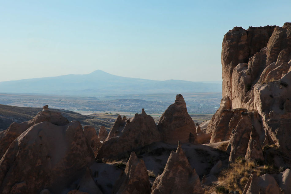 sculpted rock fairy chimneys Beauty In Nature Cappadocia Day Destination Extreme Terrain Fairy Chimneys Geology Landscape Nature No People Outdoors Rock - Object Scenics Sculpted Tranquil Scene Tranquility Travel Turkey