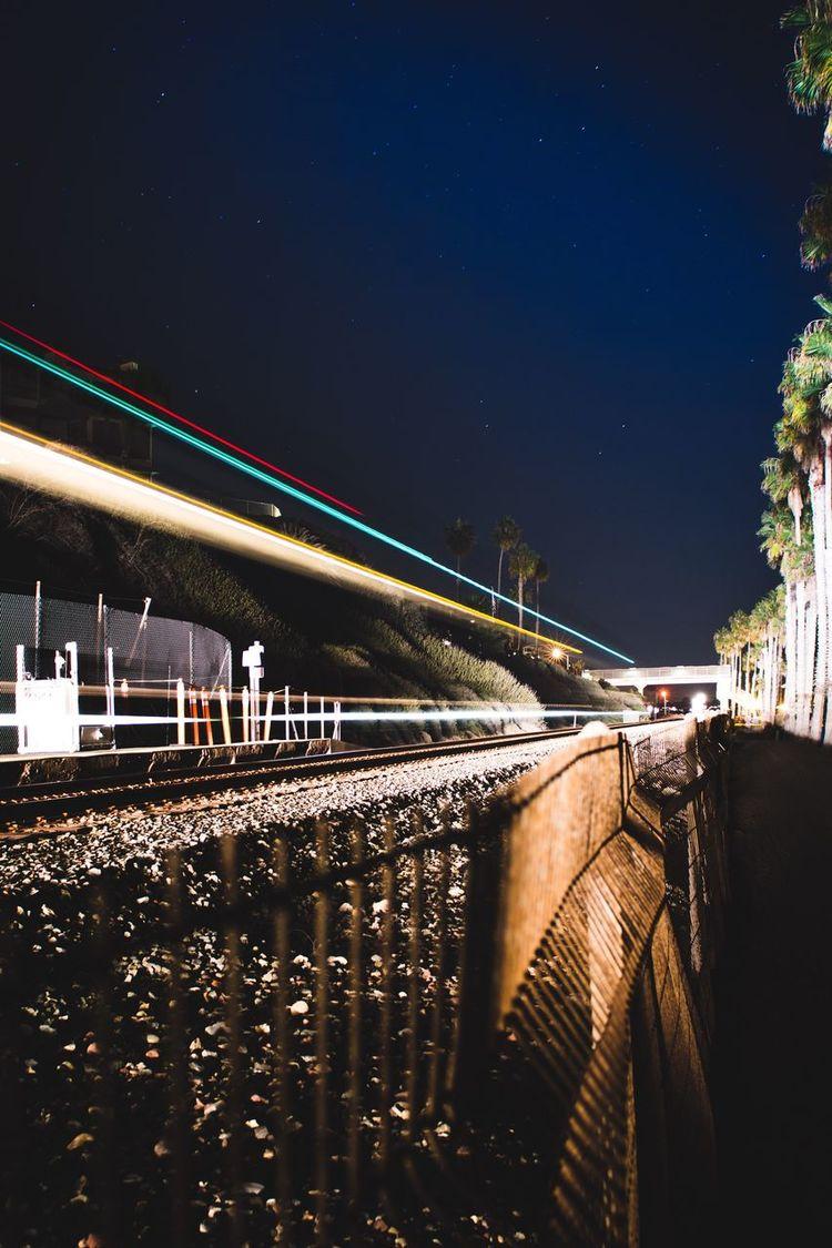 Outdoors Transportation Sky Night No People Train Train Tracks Long Exposure Stars Palm Tree Beach Bestoftheday Best Of EyeEm Light Lightbeam