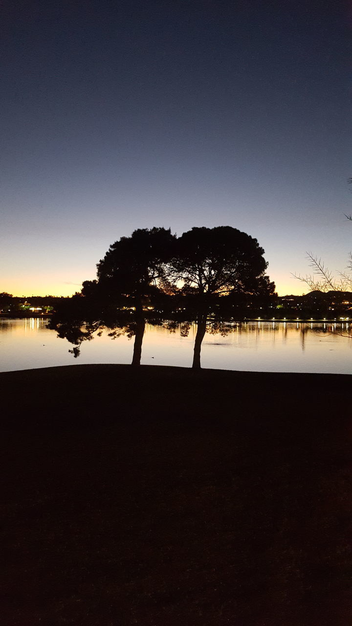 silhouette, tree, sunset, tranquil scene, beauty in nature, nature, tranquility, clear sky, scenics, water, sky, outdoors, landscape, lake, no people, day
