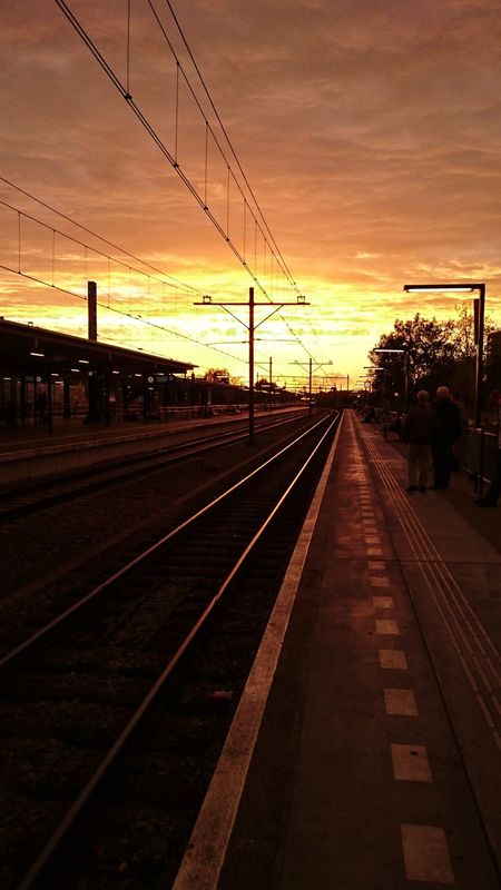 Railroad Track Transportation Rail Transportation Sunset Sky The Way Forward Railroad Station Overnight Success electricity pylon Vanishing Point Diminishing Perspective Cable Outdoors Railway Track Power Line  Orange Color Cloud - Sky Straight Scenics Power Supply From My Point Of View Road To Nowhere Gouda Netherlands (c) 2016 Shangita Bose All Rights Reserved