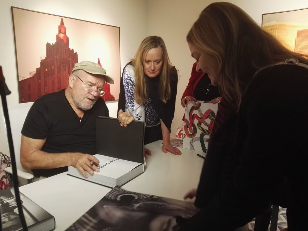 Book sign with Peter Lindbergh, my girlfriend show him a photo from her. Lifestyles Peter Lindbergh Real People