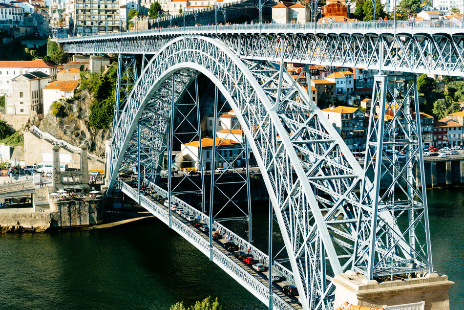 Architecture Bridge - Man Made Structure Built Structure Cars City Connection Day Douro  Holiday Metal No People Oporto Outdoors Ponte Porto Portugal River Traffic Tram Transportation Travel Travel Destinations Vacations Vila Nova De Gaia Water