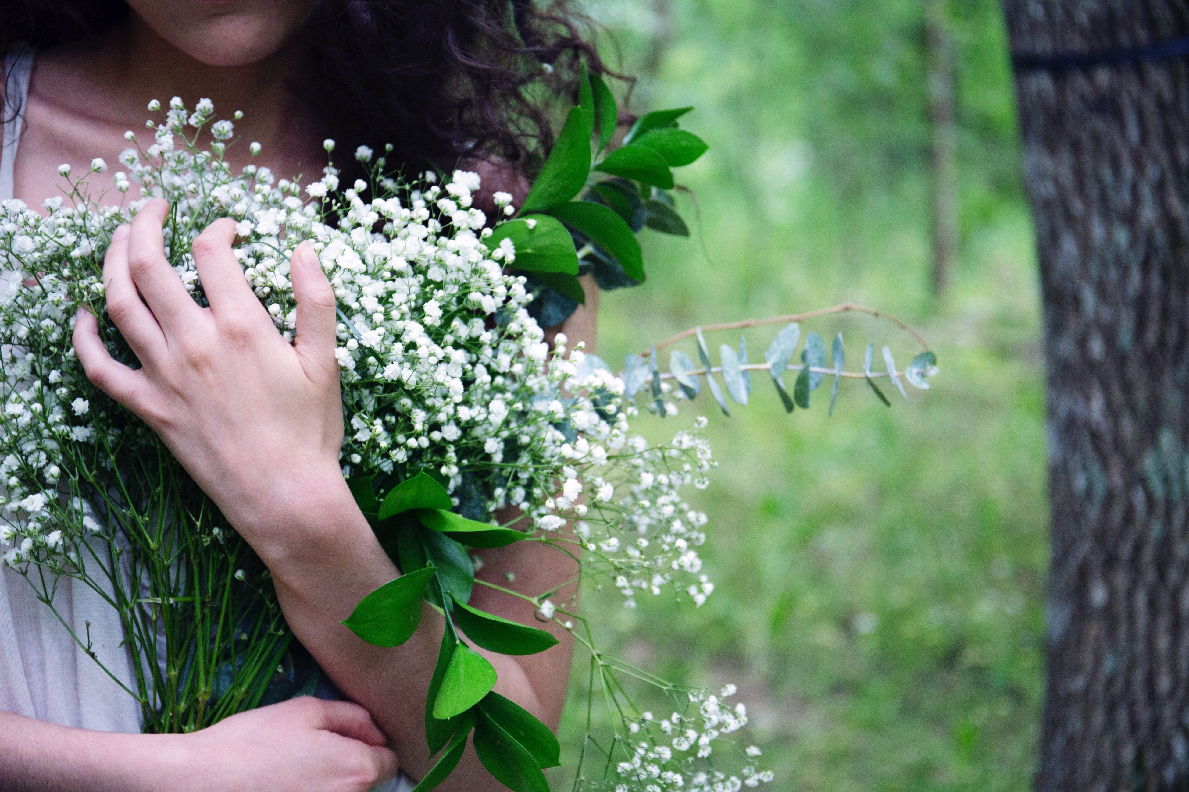 person, holding, part of, cropped, human finger, unrecognizable person, lifestyles, personal perspective, leisure activity, focus on foreground, freshness, close-up, flower, plant, green color, nature