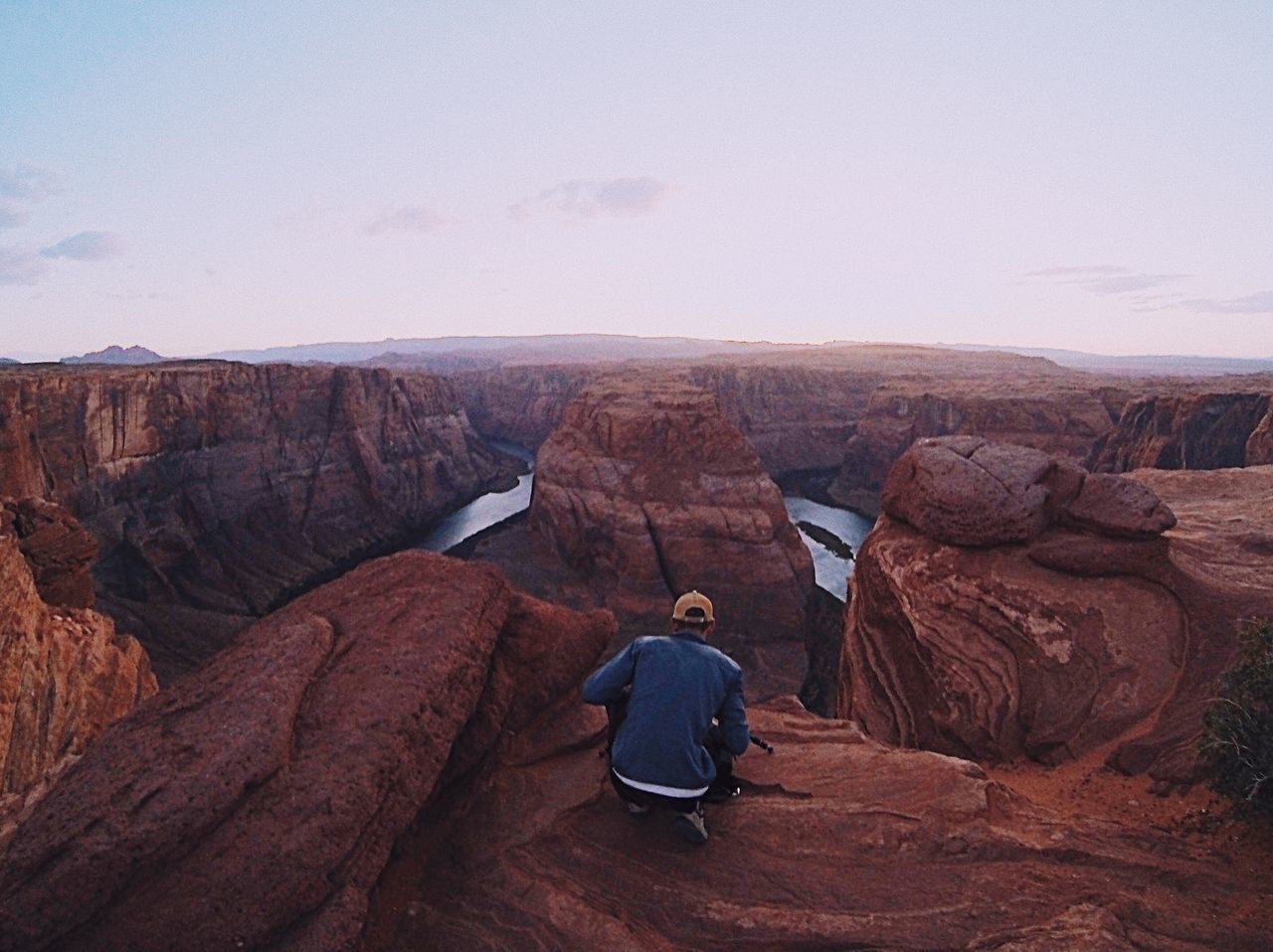 The Adventure Photographer Full Length Rock - Object Rock Formation Tranquility Physical Geography Outdoors Beauty In Nature Real People Nature One Person Day Scenics Sky Tranquil Scene Adventure Young Adult People One Man Only Adult Horseshoe Bend Photographer Gopro Miles Away