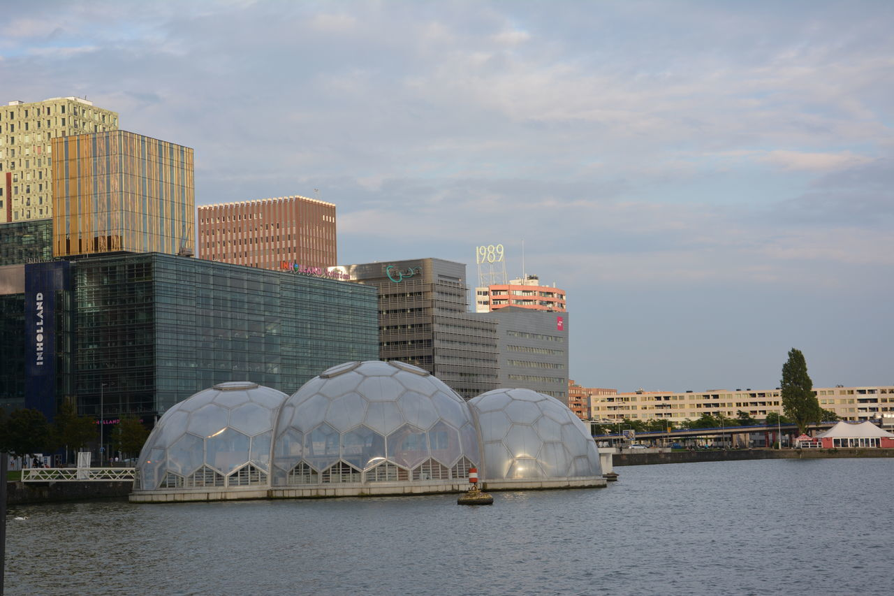 architecture, built structure, building exterior, city, water, waterfront, sky, skyscraper, outdoors, cityscape, day, nautical vessel, no people, sea, urban skyline