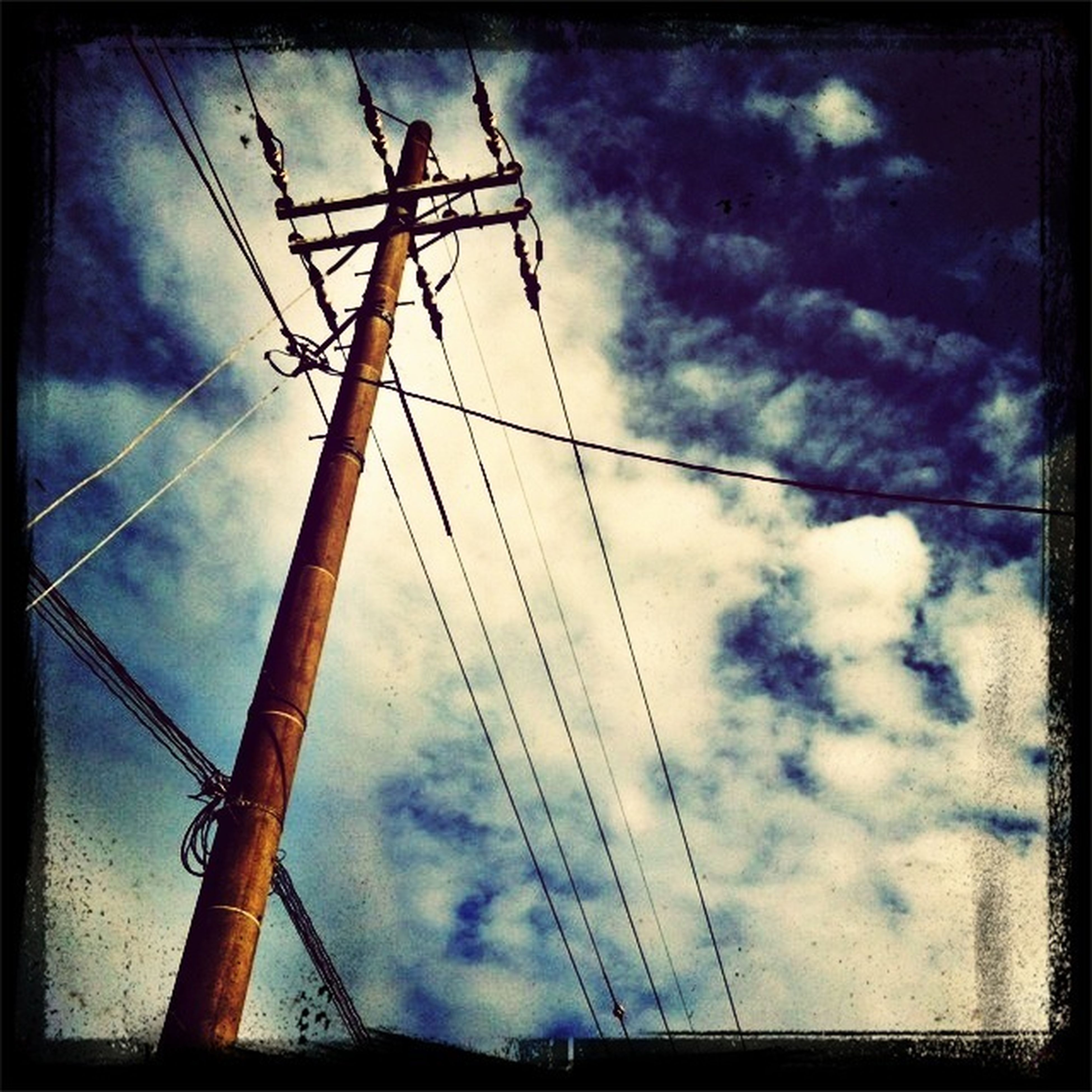 power line, power supply, electricity pylon, transfer print, electricity, sky, low angle view, fuel and power generation, technology, connection, cloud - sky, cable, auto post production filter, cloudy, silhouette, cloud, crane - construction machinery, construction site, development, power cable