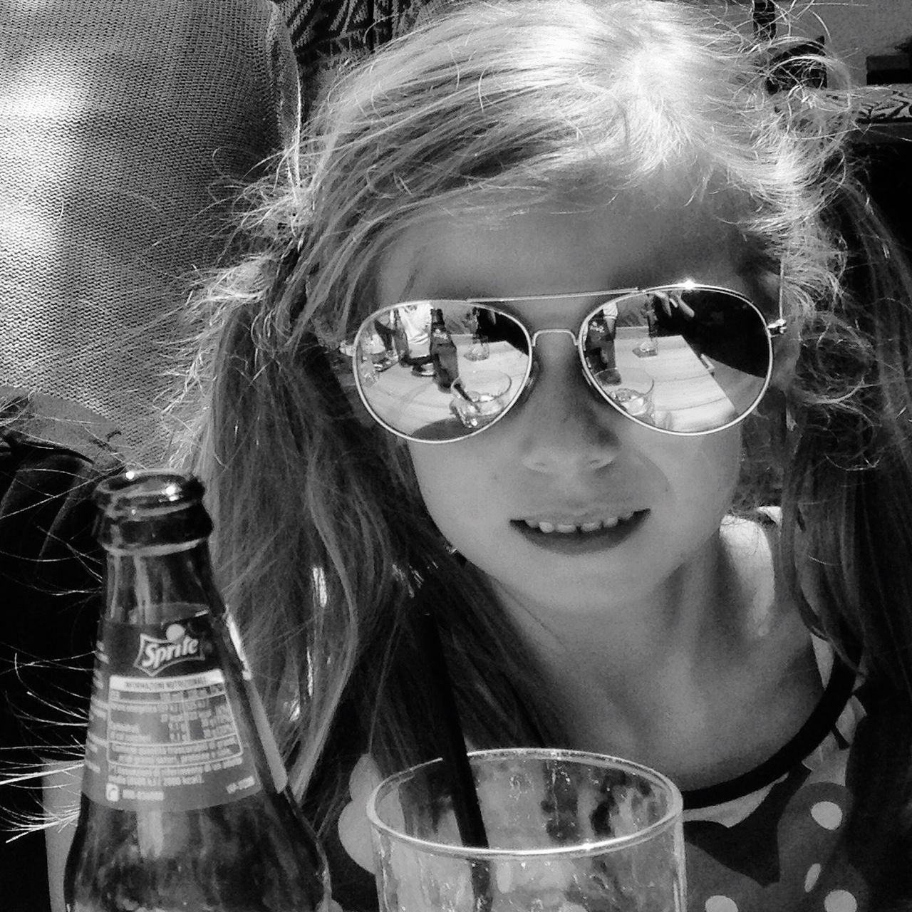 sunglasses, drinking glass, one person, childhood, headshot, real people, looking at camera, portrait, girls, smiling, close-up, day, people