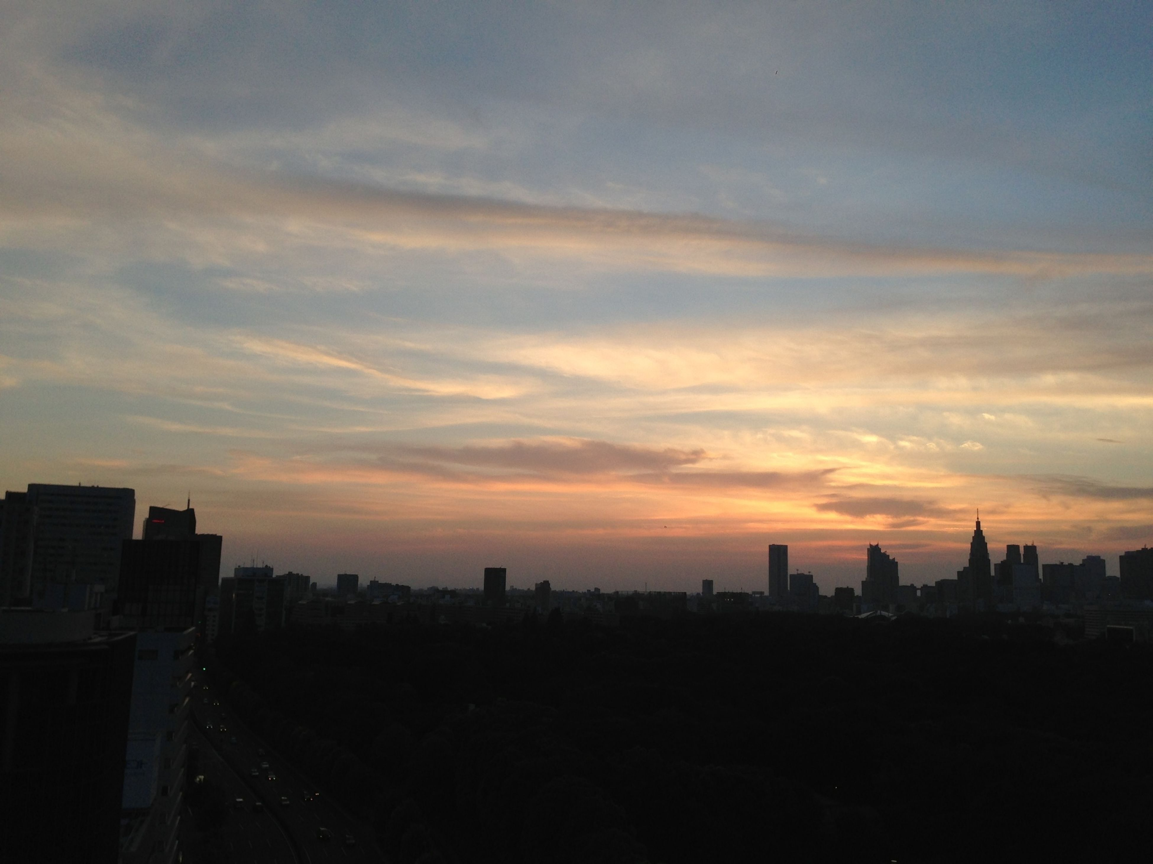 sunset, silhouette, building exterior, architecture, built structure, sky, orange color, city, cloud - sky, cityscape, scenics, beauty in nature, nature, outdoors, cloud, dramatic sky, dusk, dark, no people, building
