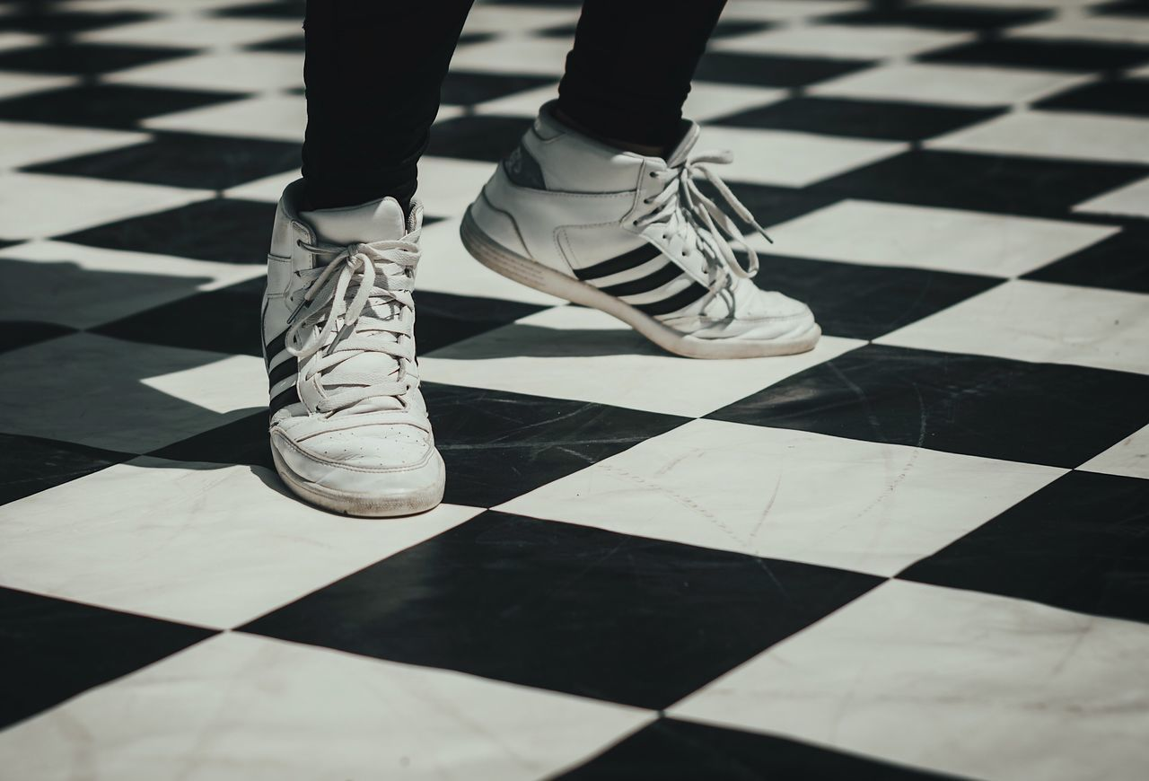 dancing on the chessboard low section checked pattern tiled floor human leg indoors Shoe real people lifestyles one person close-up day people blackandwhite