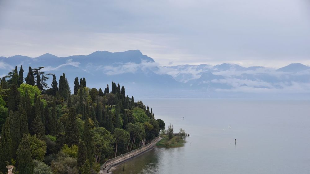 Sirmione sul lago di Garda Mountain Nature Beauty In Nature Water Mountain Range Tranquility Scenics Sky Tranquil Scene Outdoors No People Architecture Day Tree Sea Building Exterior Lago Di Garda Beauty In Nature Enjoying The View Cloudy Day Nikon Nikon D750 Cloud - Sky Light And Shadow Landscape The Great Outdoors - 2017 EyeEm Awards