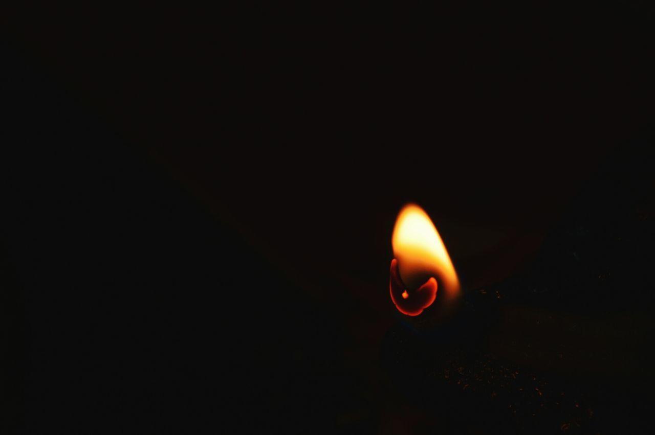 flame, burning, candle, heat - temperature, glowing, copy space, illuminated, close-up, no people, black background, studio shot, night, diya - oil lamp, indoors