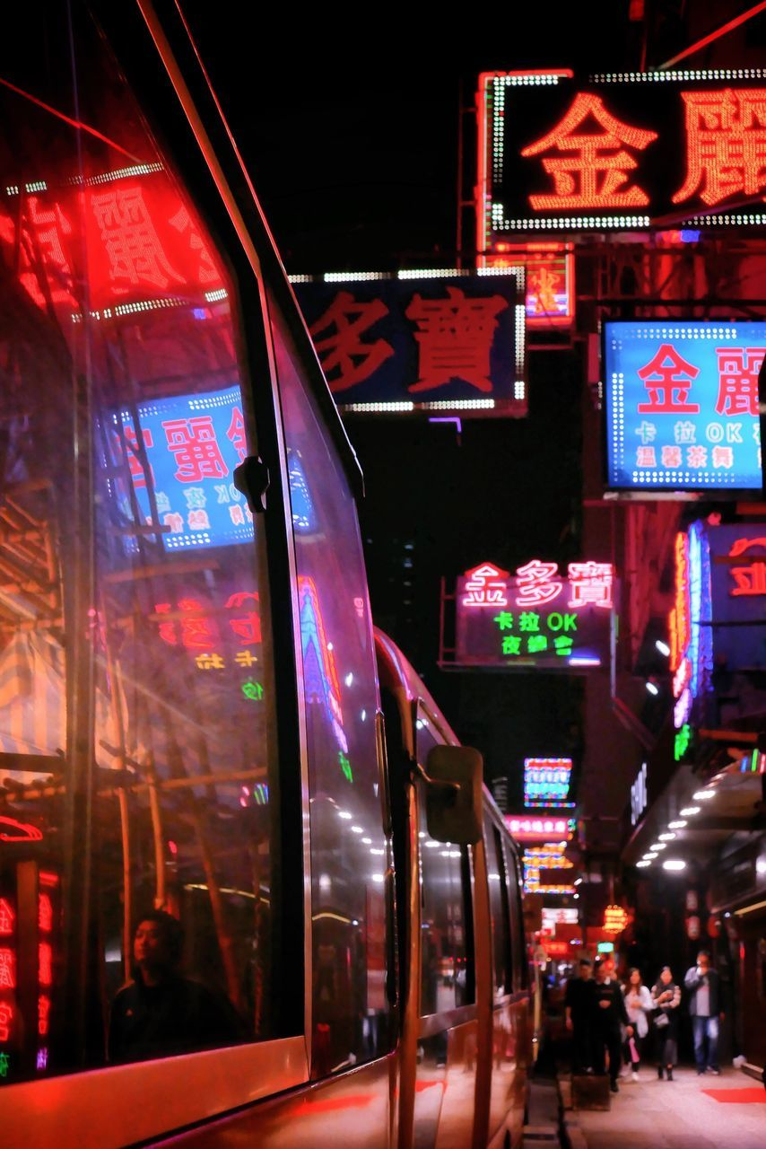 illuminated, night, text, public transportation, communication, transportation, mode of transport, land vehicle, outdoors, multi colored, neon, architecture, city, no people