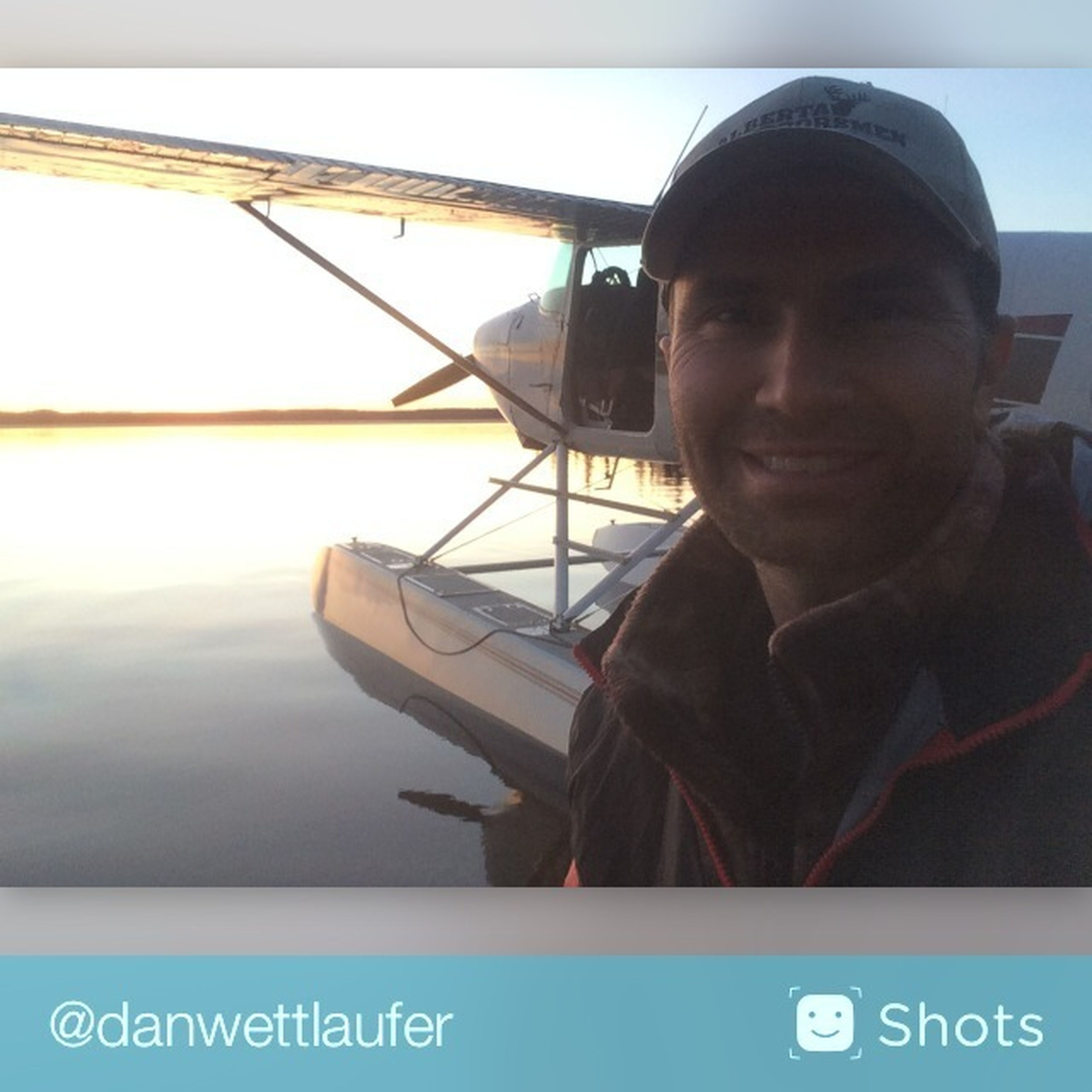 transportation, person, communication, mode of transport, lifestyles, young men, young adult, leisure activity, nautical vessel, water, text, travel, western script, headshot, portrait, boat, looking at camera, sky