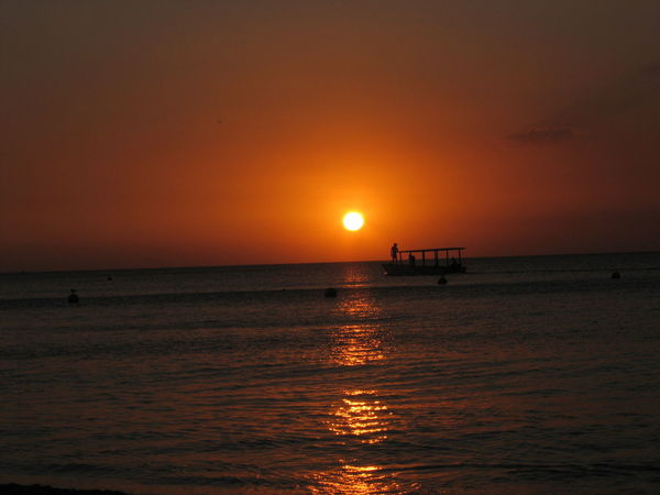 Atmosphere Atmospheric Mood Beauty In Nature Dramatic Sky Horizon Over Water Idyllic Jamaica Jamaican Majestic Nature Non-urban Scene Orange Color Scenics Sea Sky Sun Sunset Tourism Tranquil Scene Tranquility Travel Destinations Vacations Vibrant Color Water Waterfront