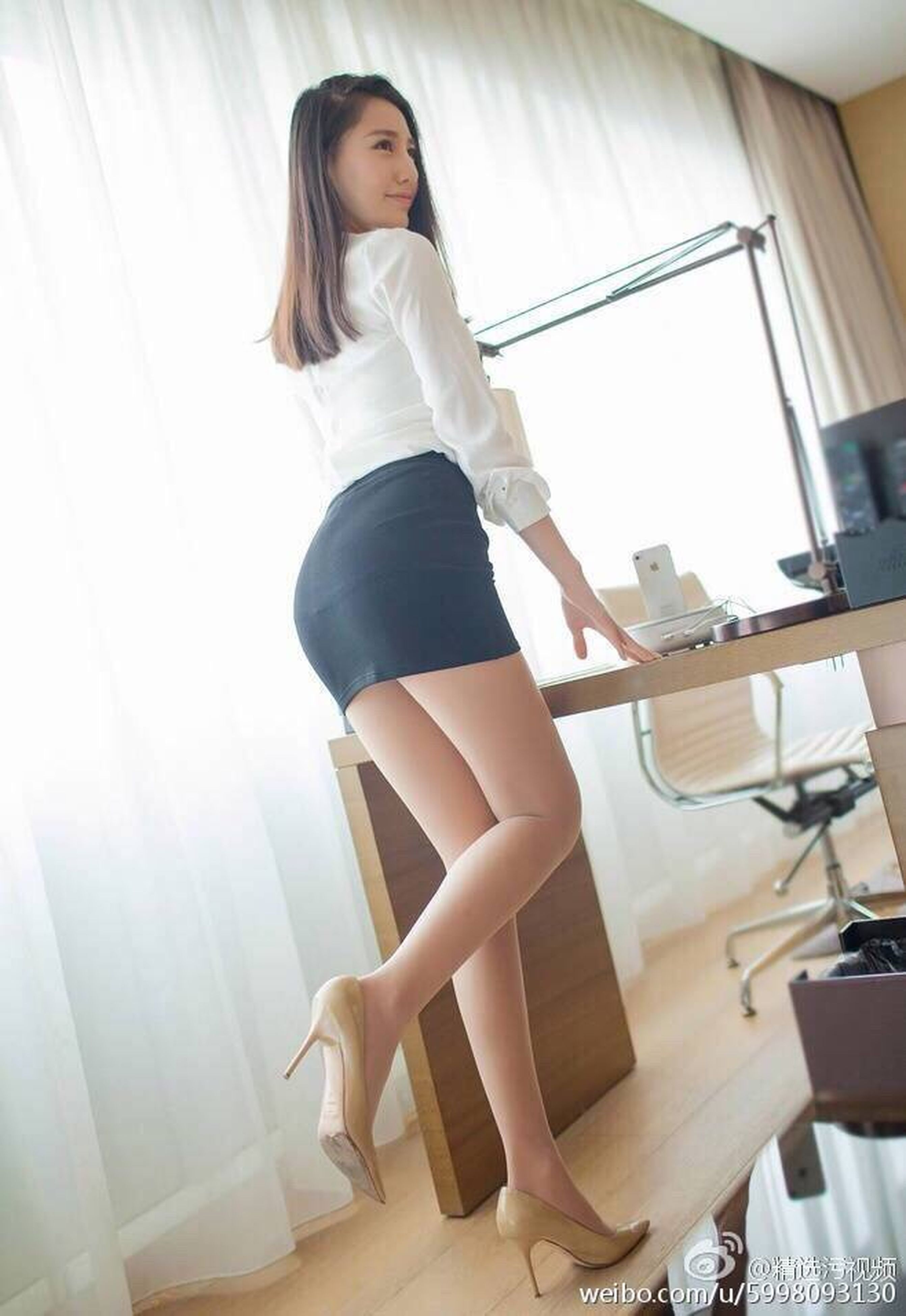 indoors, lifestyles, young women, young adult, leisure activity, full length, home interior, high heels, casual clothing, person, confidence, fashionable, long hair, looking at camera, day