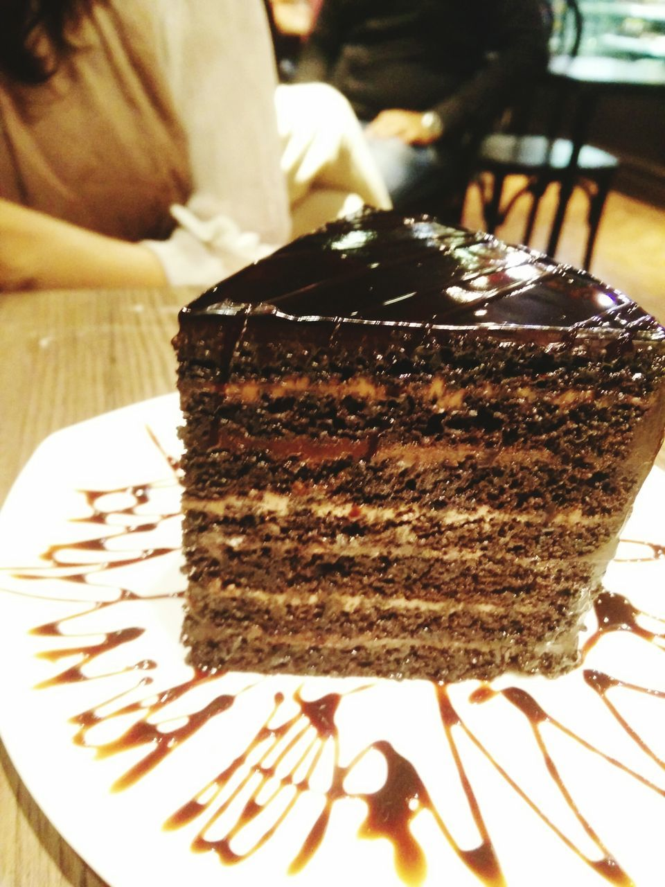 cake, sweet food, food and drink, indulgence, chocolate, dessert, food, temptation, chocolate cake, close-up, freshness, indoors, unhealthy eating, plate, ready-to-eat, human hand, human body part, day, people