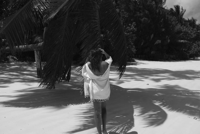 Beach Beauty In Nature Black & White Human Body Part Lifestyles One Woman Only Outdoors Palm Tree Rear View Shadow Tropical Climate Vacations White Sand Seychelles Islands Praslin TCPM The Great Outdoors - 2017 EyeEm Awards Live For The Story Sommergefühle Love Yourself