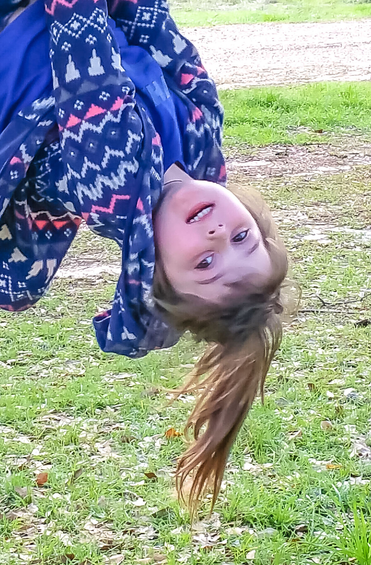 Real People Day Grass Leisure Activity Smiling Childhood Happiness Outdoors Young Women Young Adult Lifestyles One Person Portrait People Adult Hanging Upside Down Climbing Trees Playing Outside Ponytail Upside Down Having Fun Child Playing Naturelovers Child Only Girls