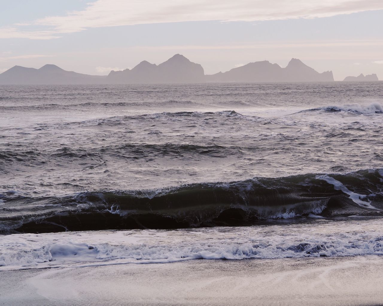 Sea Beauty In Nature Nature Water Beach Scenics Tranquil Scene Wave Mountain Shore Sand No People Tranquility Outdoors in Iceland Sunset