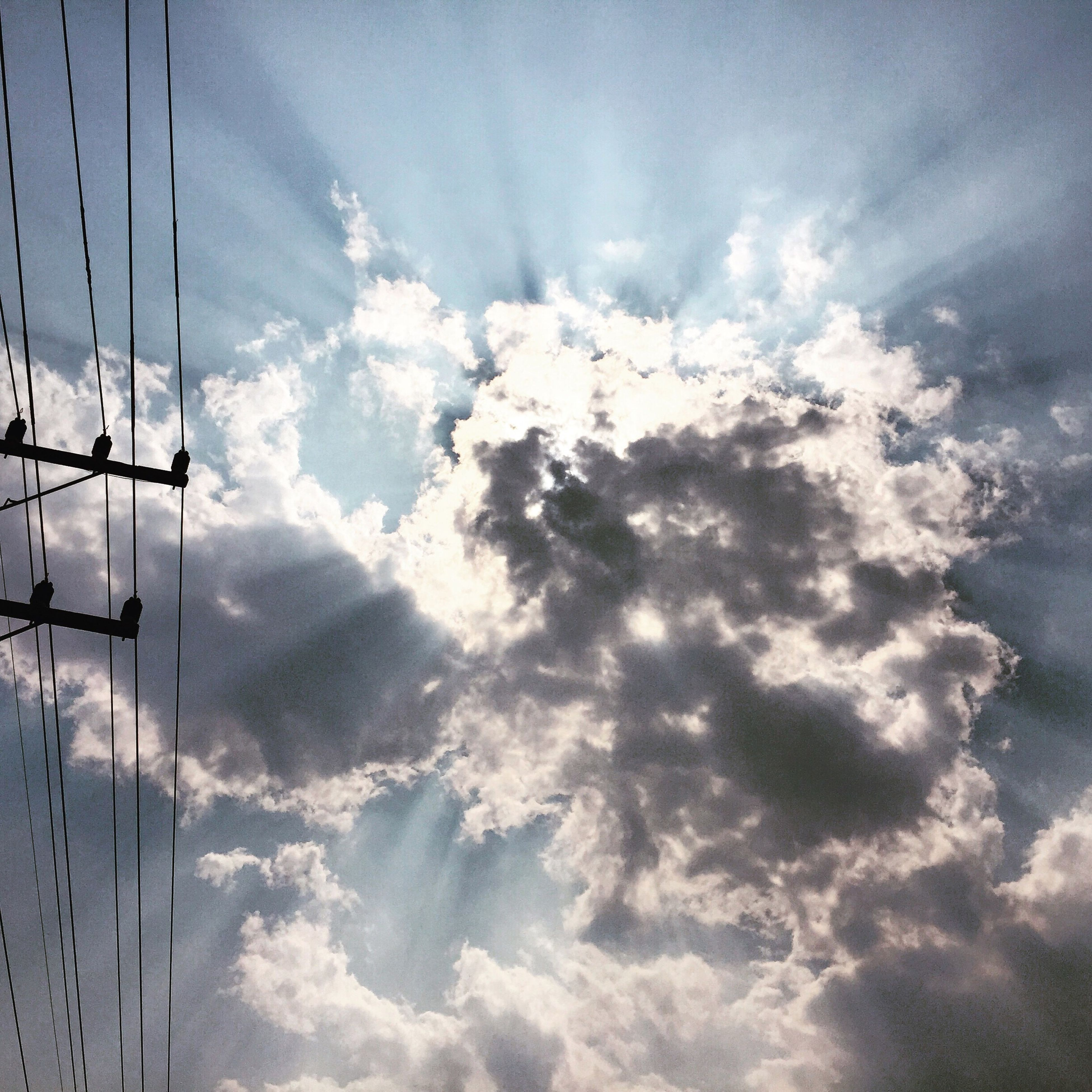 sky, cloud - sky, low angle view, cloudy, power line, electricity, electricity pylon, cloud, power supply, cable, tranquility, nature, connection, weather, beauty in nature, fuel and power generation, scenics, cloudscape, technology, tranquil scene